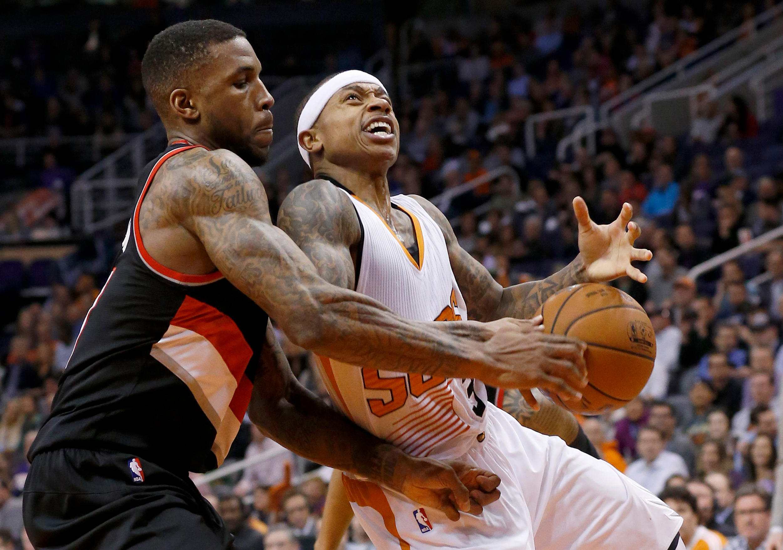 Portland Trail Blazers' Thomas Robinson, left, strips the ball from Phoenix Suns' Isaiah Thomas during the second half of an NBA basketball game Wednesday, Jan. 21, 2015, in Phoenix.