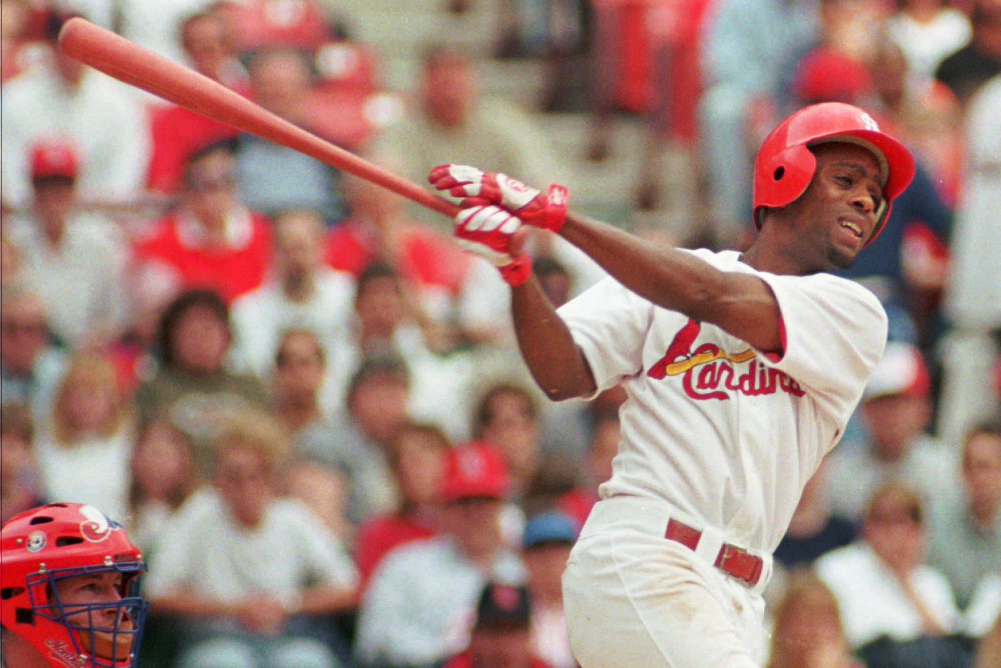 St. Louis Cardinals Delino DeShields swings during the first inning against the Montreal Expos Wednesday, April 29, 1998, at Busch Stadium in St. Louis. DeShields was among league-leaders in batting average and triples during the 1998 season.