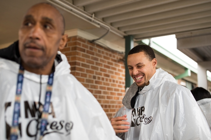 Steph Curry laughs as he exits a volunteer event at William Hart Elementary School. NBA players volunteer their time to help better the New Orleans community through the NBA Cares program.