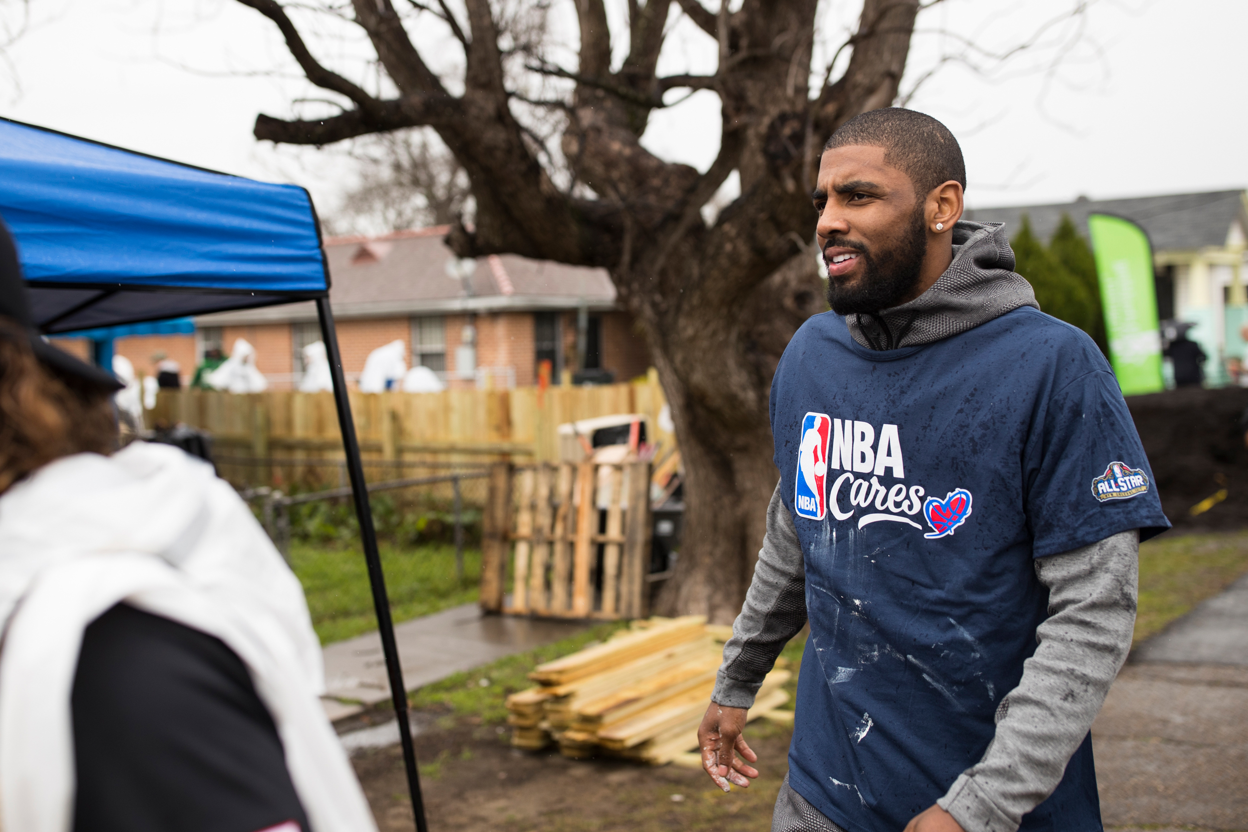 Kyrie Irving exits a volunteer event helping to refurbish homes and plant a community garden in New Orleansí Hollygrove-Dixon neighborhood. NBA players volunteer their time to help better the New Orleans community through the NBA Cares program.