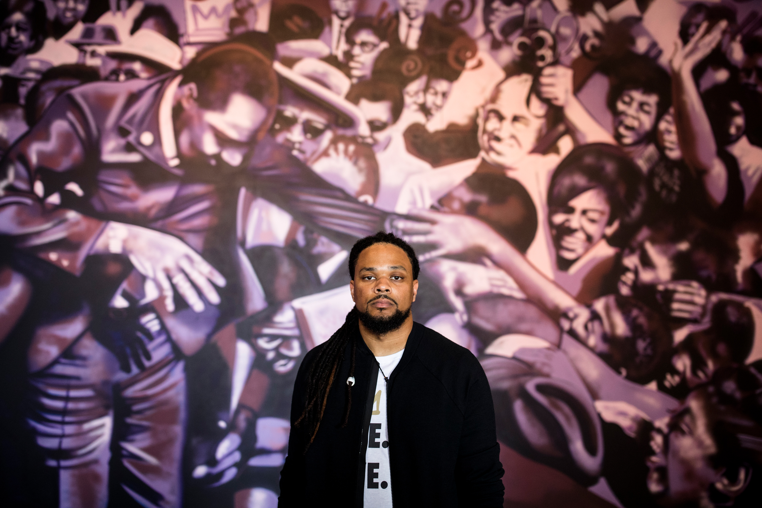 "New Orleans-based artist Brandan ""BMIKE"" Odums poses for a portrait in his gallery showing in partnership with Nike at STUDIO BE in New Orleans."