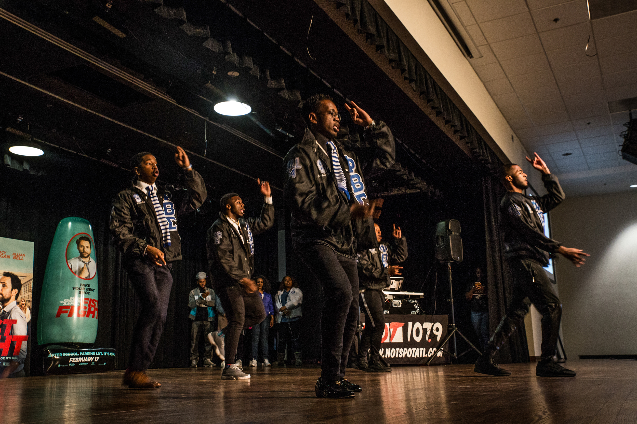 Phi Beta Sigma brothers perform routine for crowd at stroll off.