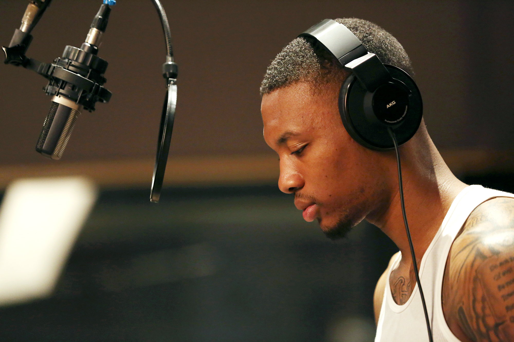"Dame D.O.L.L.A. listens to playback while recording tracks for his debut album, ""The Letter 'O.'"""
