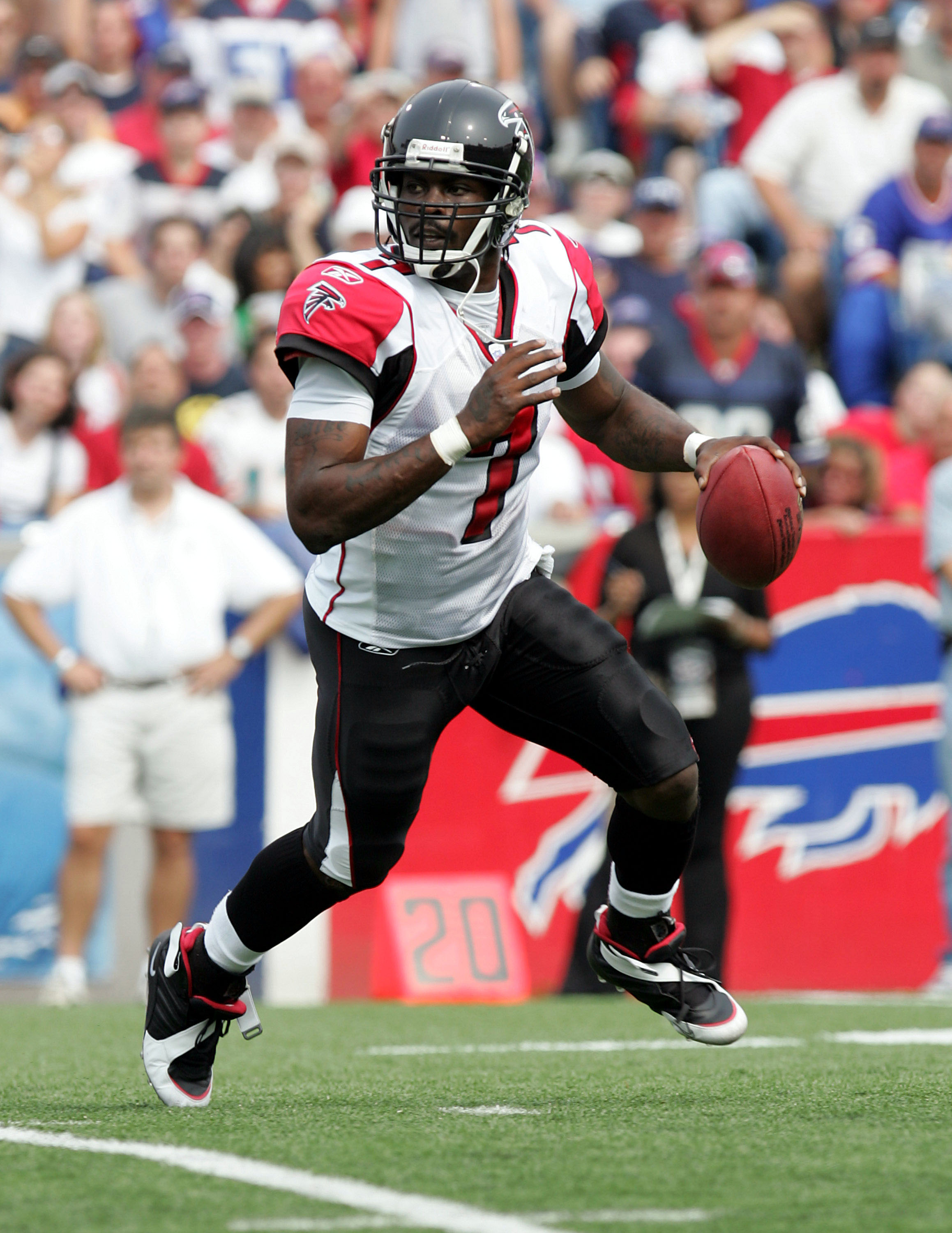 Atlanta Falcons quarterback Michael Vick (7) looks downfield for a receiver during the game against the Buffalo Bills at Ralph Wilson Stadium in Orchard Park, New York. on Sept. 25, 2005.