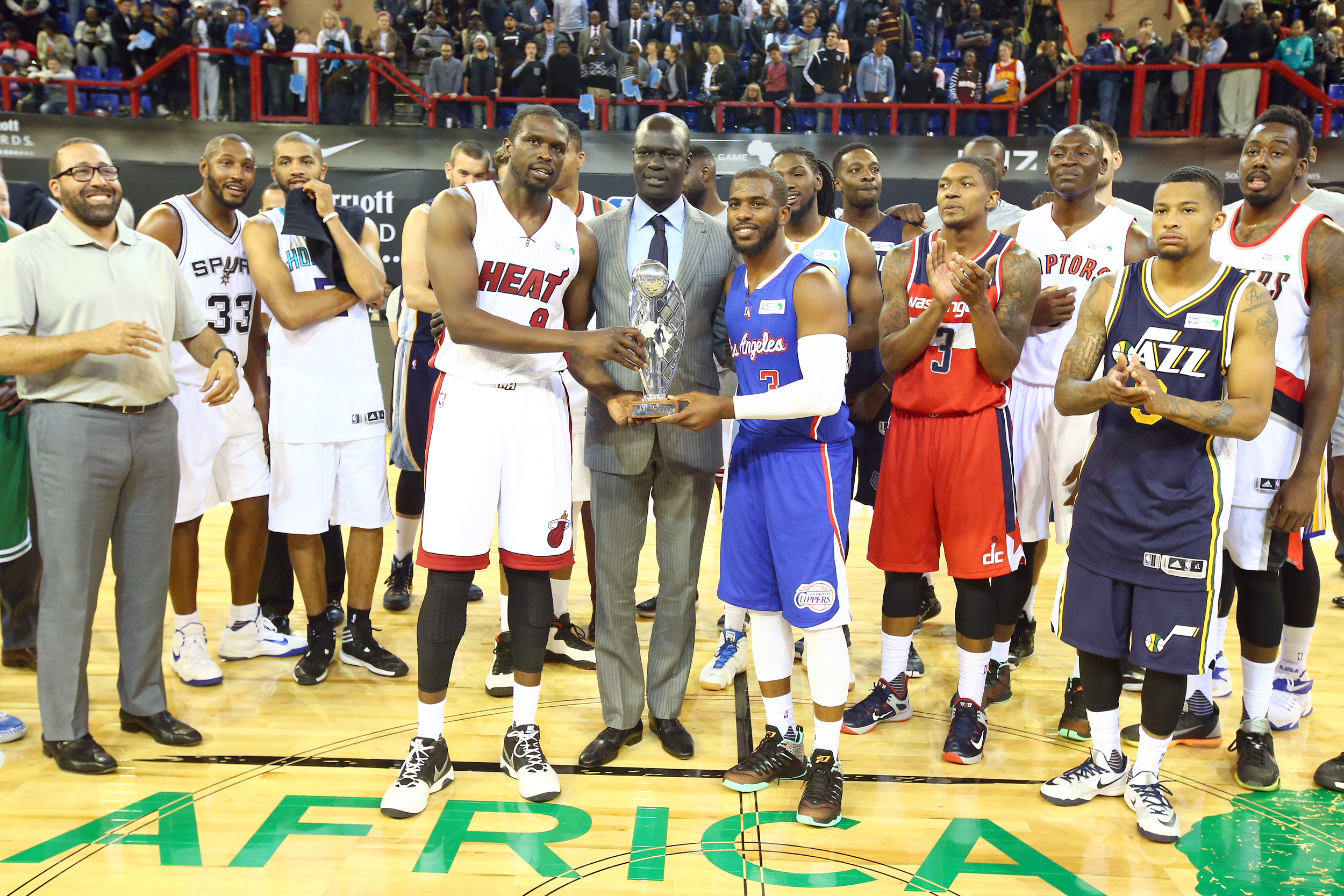 NBA Africa Vice President & Managing Director Amadou Gallo Fall presents Captain Luol Deng #9 of Team Africa and Captain Chris Paul #3 of Team World the MVP Trophy after the NBA Africa Game 2015 as part of Basketball Without Borders on August 1, 2015 at the Ellis Park Arena in Johannesburg, South Africa.