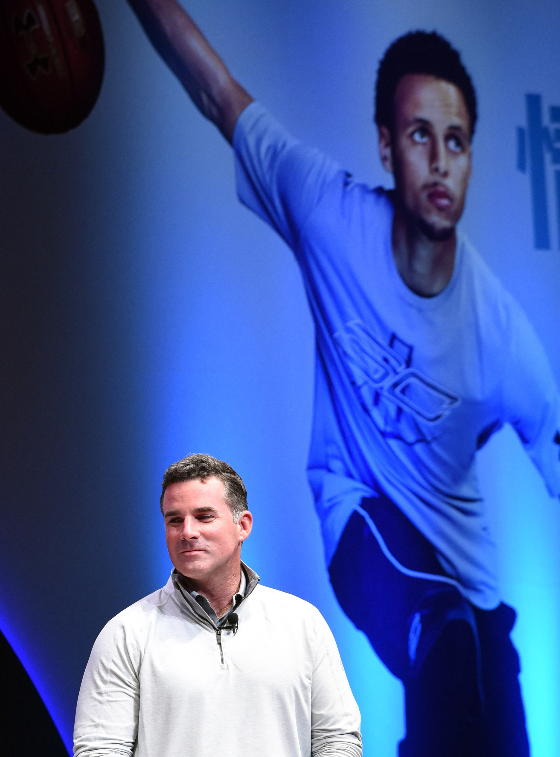 Under Armour (UA) founder, chairman and CEO Kevin Plank attends an event with National Basketball Association (NBA) Golden State Warriors 2014-2015 season MVP Stephen Curry in Tokyo on September 4, 2015.