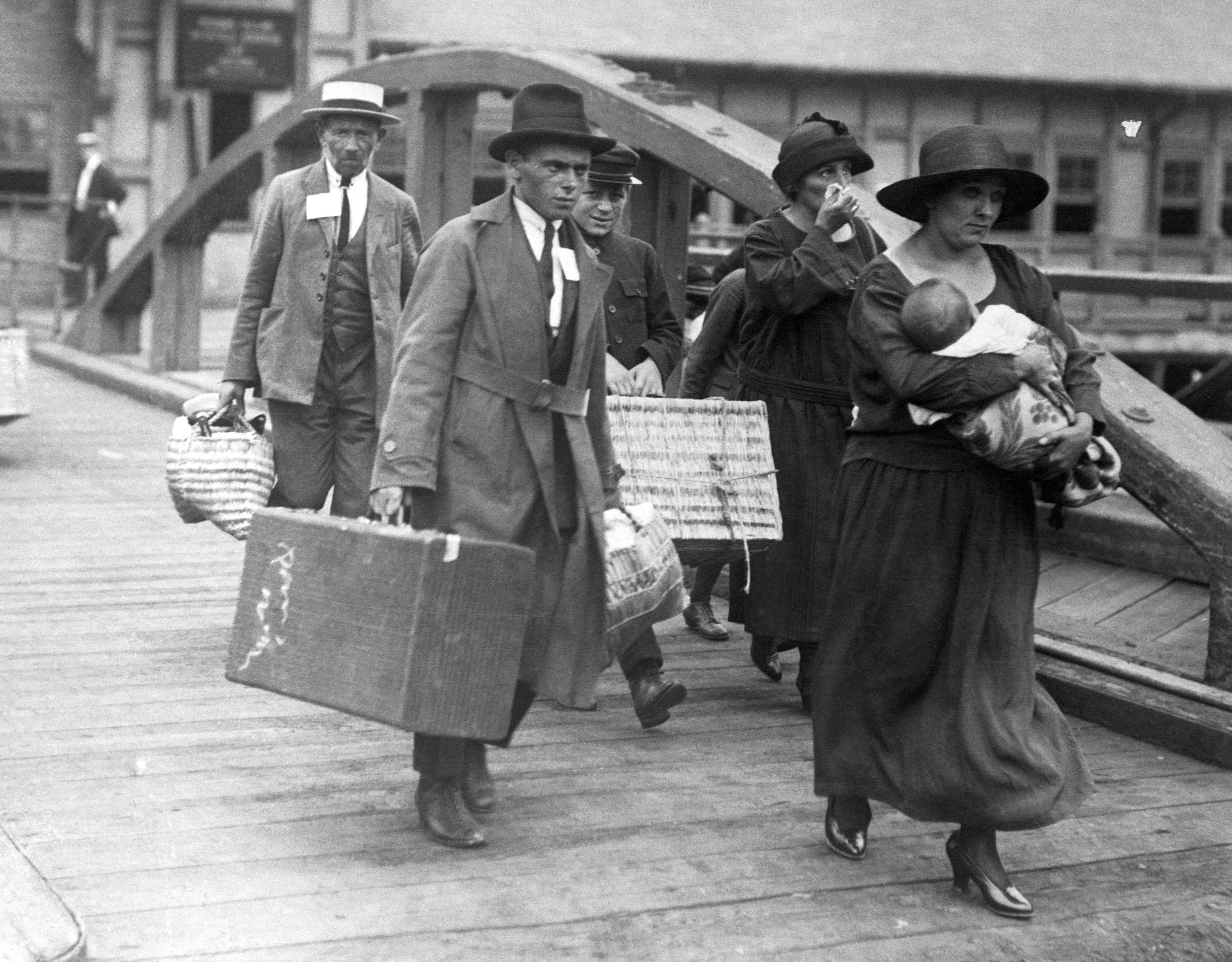 Ship loaded with immigrants, coming to New York. A Greek family embarking on Ellis Island, to come to America.