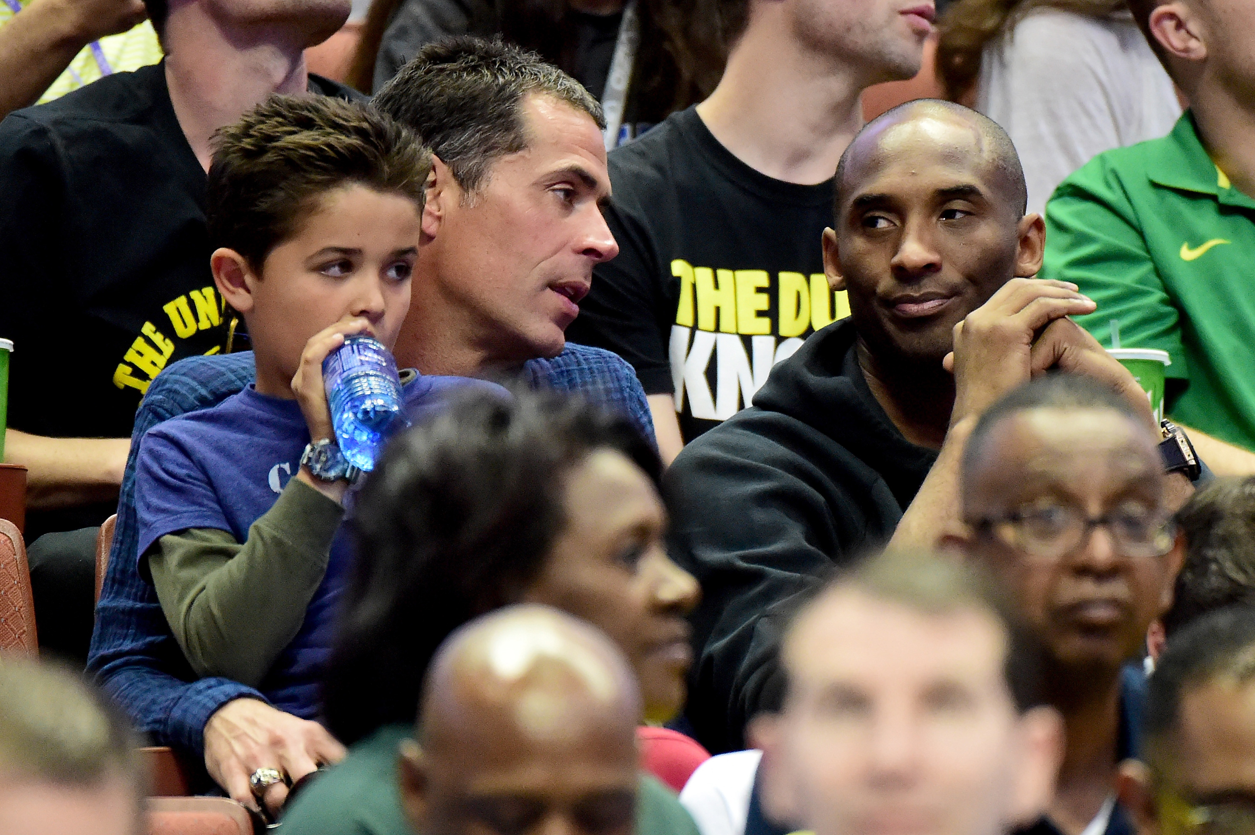 Agent Rob Pelinka talks with Kobe Bryant during the NCAA Men's Basketball Tournament West Regional Final at Honda Center on March 26, 2016 in Anaheim, California.