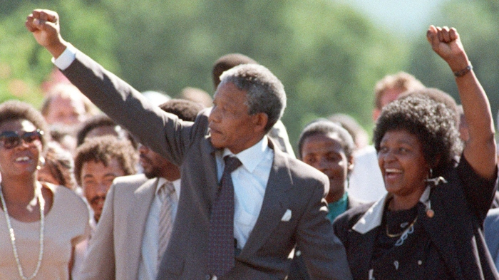 ANC leader Nelson Mandela and wife Winnie raise fi