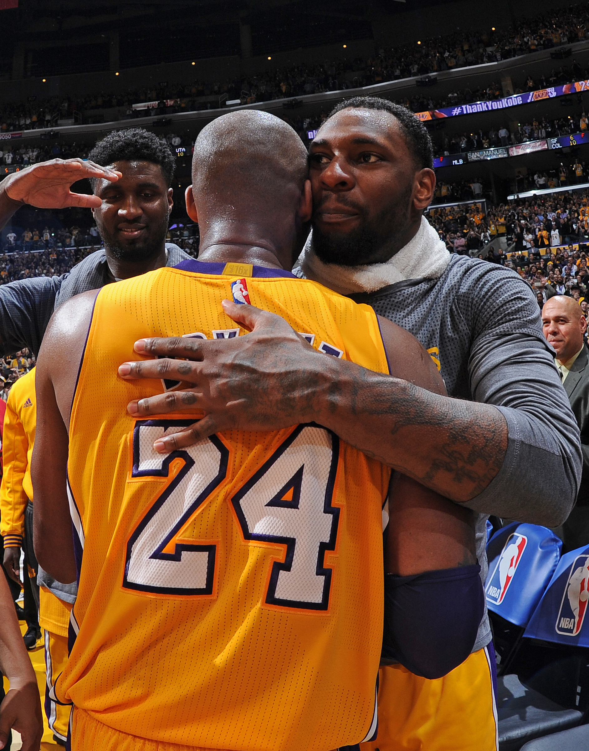 Kobe Bryant #24 and Tarik Black #28 of the Los Angeles Lakers hug after the game against the Utah Jazz at STAPLES Center on April 13, 2016 in Los Angeles, California.