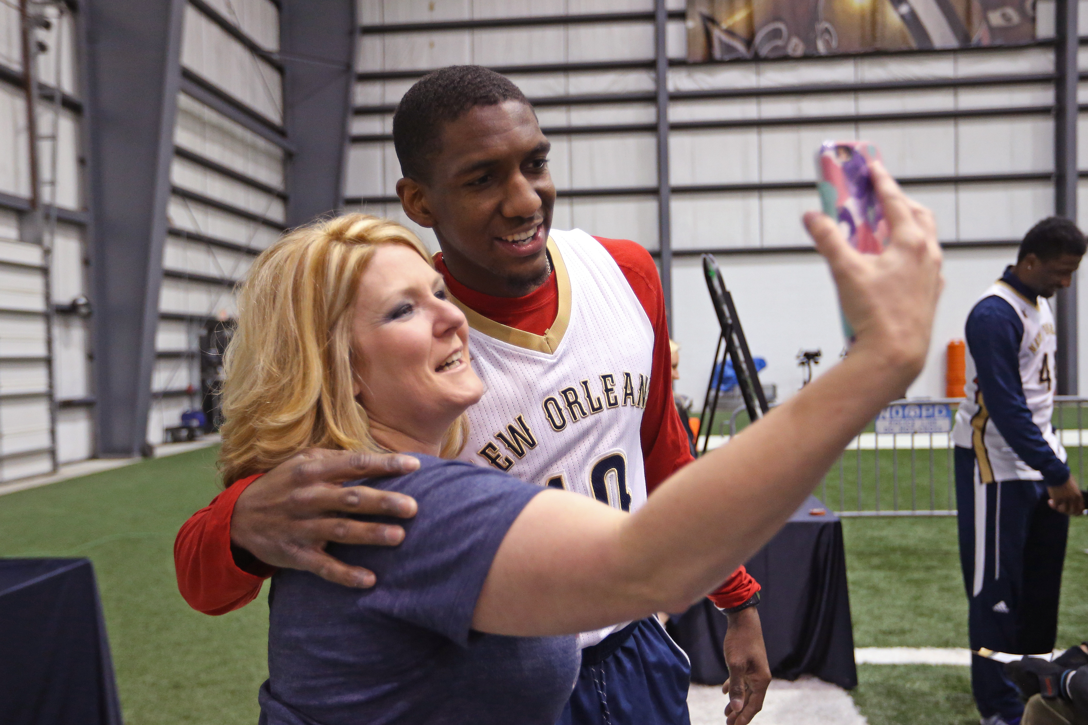 Langston Galloway #10 of the New Orleans Pelicans takes a selfie with fans as the Pelicans hold their annual season tickets sales event on January 28, 2017 at New Orleans Saints/Pelicans Practice Facility in New Orleans, Louisiana.