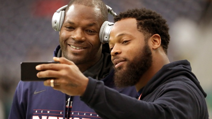 New England Patriots tight end Martellus Bennett (88) poses for a selfie with his brother Michael Bennett who plays for the Seattle Seahawks while on the field for pre game warm ups. The Atlanta Falcons play the New England Patriots in Super Bowl LI at NRG Stadium in Houston on Feb. 5, 2017.