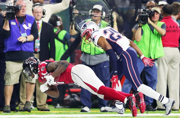 Julio Jones #11 of the Atlanta Falcons makes a catch over Eric Rowe #25 of the New England Patriots in the fourth quarter during Super Bowl 51 at NRG Stadium on February 5, 2017 in Houston, Texas.
