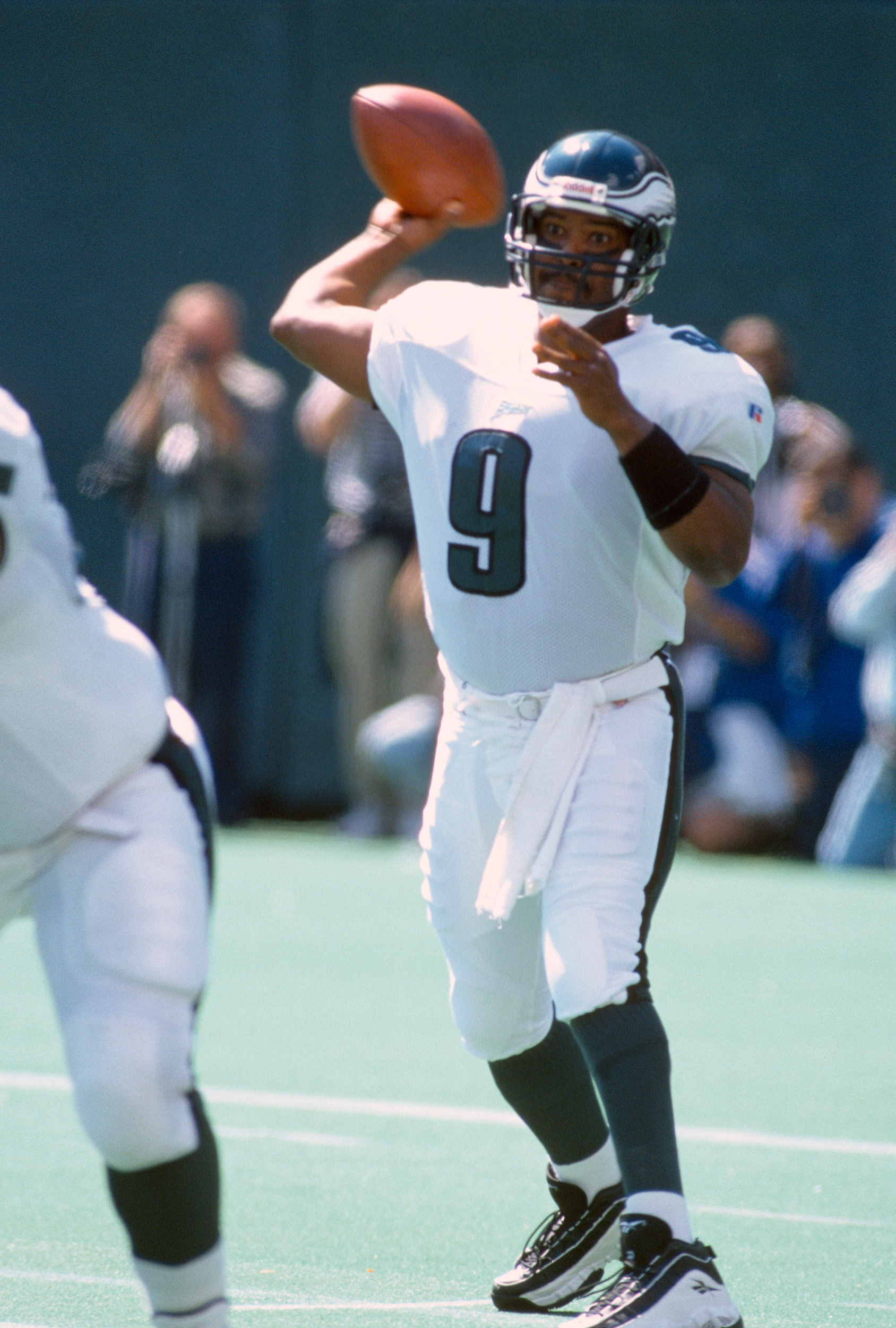 Rodney Peete #9 of the Philadelphia Eagles throws a pass against the Detroit Lions during an NFL Football game September 15, 1996 at Veterans Stadium in Philadelphia, Pennsylvania. Peete played for the Eagles from 1995-98.