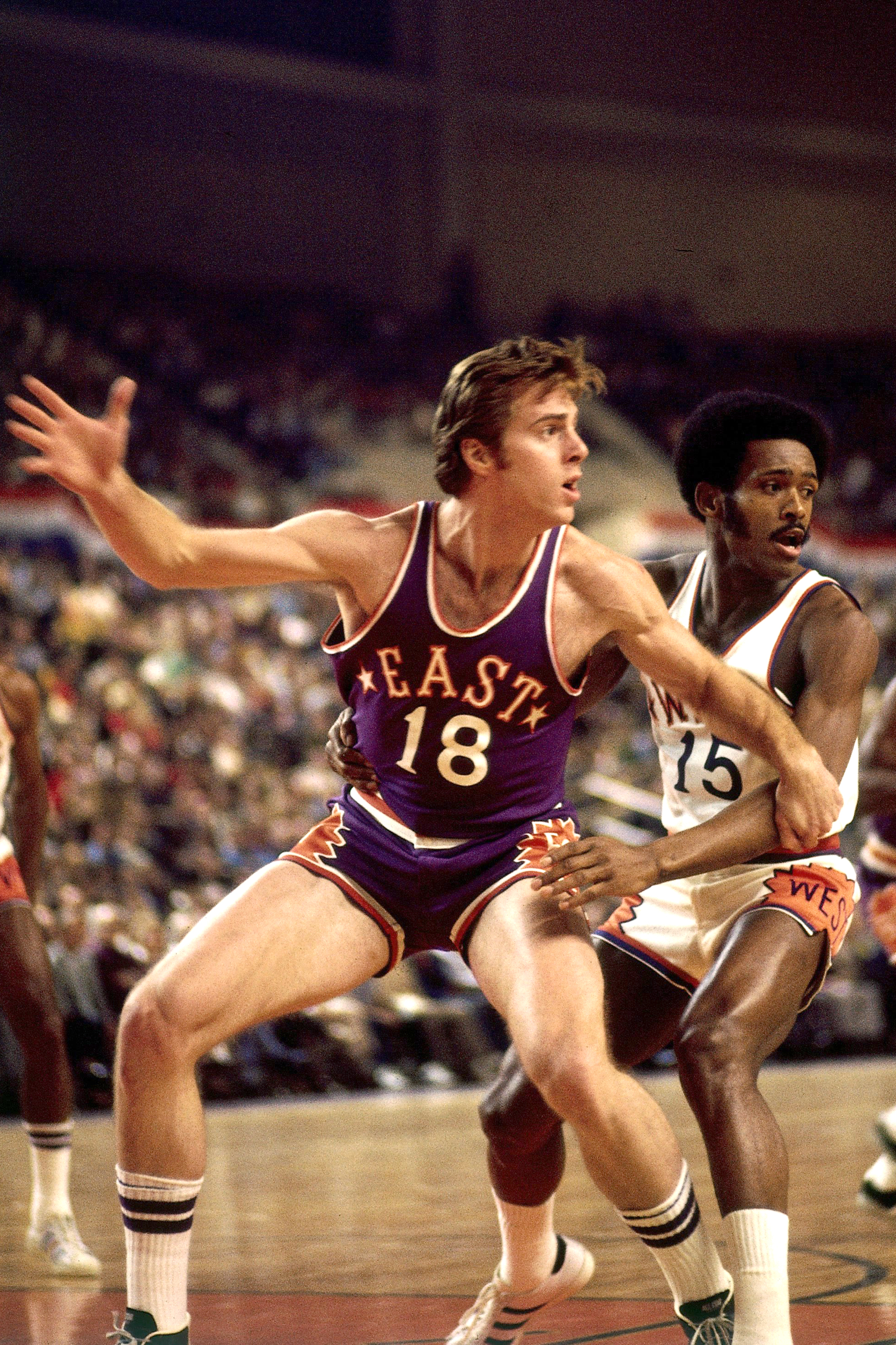 Dave Cowens #18 of the East All Stars posts up during the 1975 All Star Game on January 14, 1975 at the Veterans Memorial Coliseum in Phoenix, Arizona.