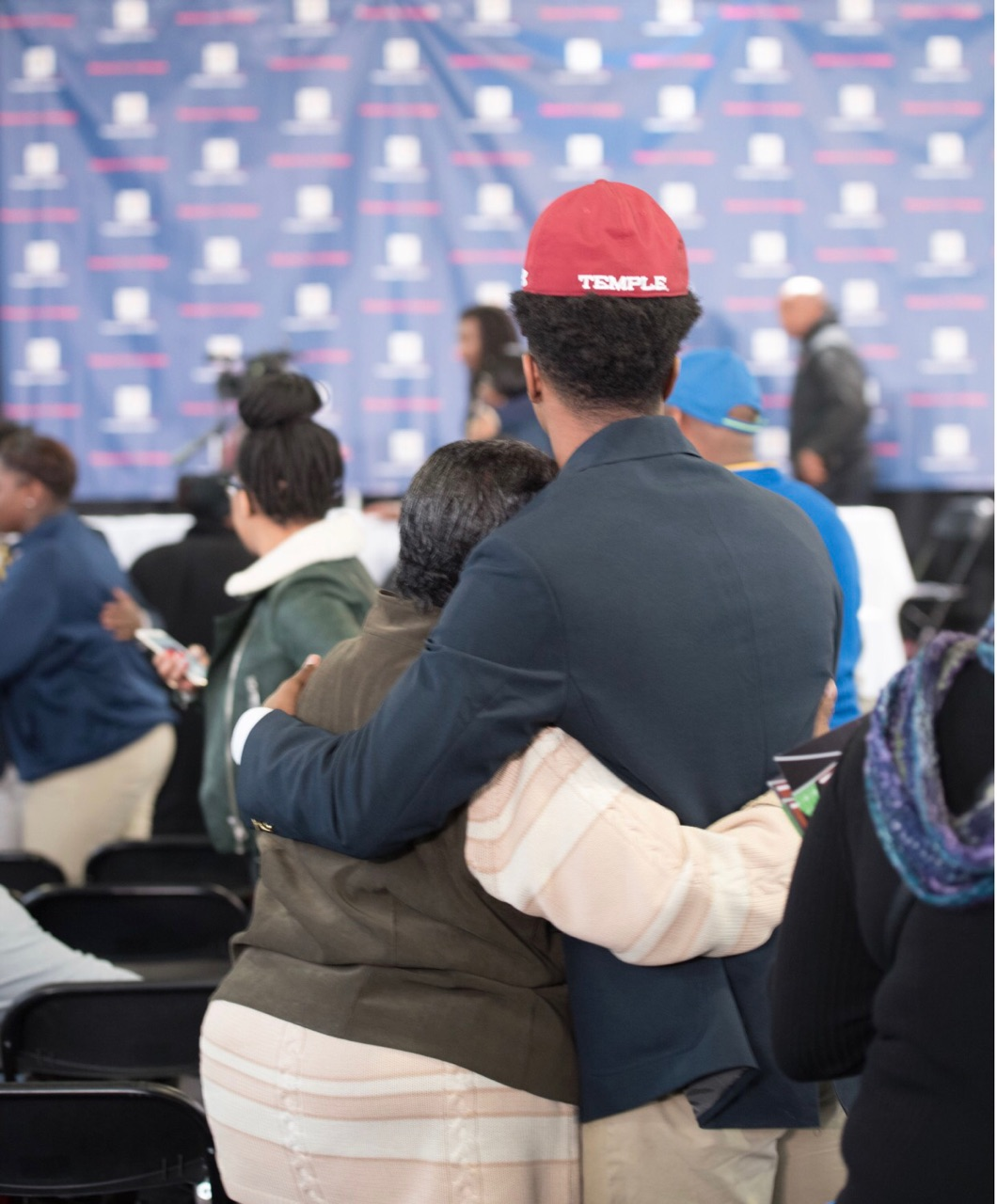 Christian Braswell who signed his letter of intent to attend Temple University hugs his mother during Friendship Academy's signing day event on February 1, 2017