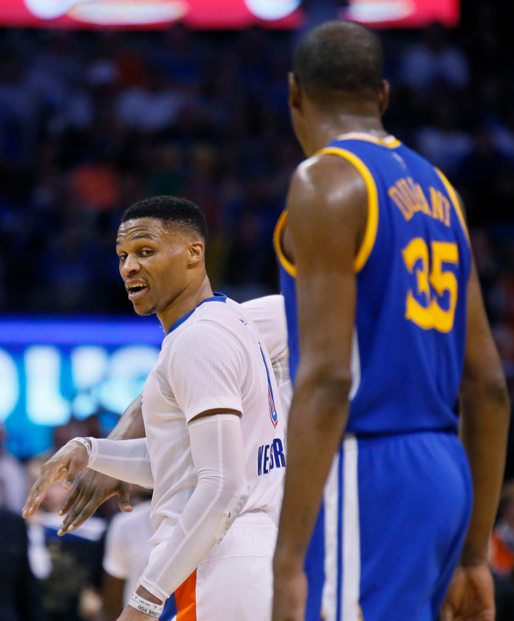 Oklahoma City Thunder guard Russell Westbrook, left, comments to Golden State Warriors forward Kevin Durant (35) as they walk offcourt for a timeout in the third quarter of an NBA basketball game in Oklahoma City, Saturday, Feb. 11, 2017.