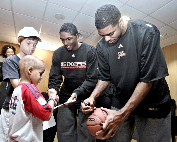 US NBA basketball Philadelphia 76ers player Louis Williams, left, and his teammate Rodney Carney, right, sign autographs in the Sant Joan de Deu infants hospital in Barcelona, Spain, Tuesday, Oct. 3, 2006. Philadelphia 76ers will play against Winterthur FC Barcelona next Thursday, Oct. 5, 2006.