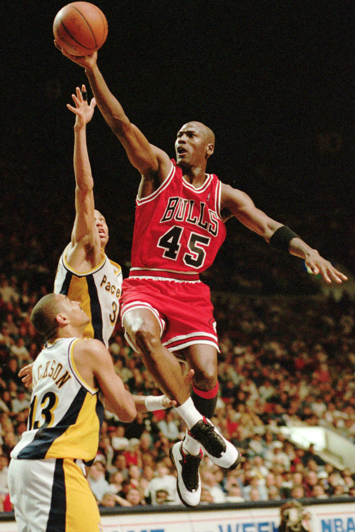 Chicago Bulls guard Michael Jordan flies to the hoop over the Indiana  Pacers  Reggie Miller and Mark Jackson (No. 13) 62dc81cba