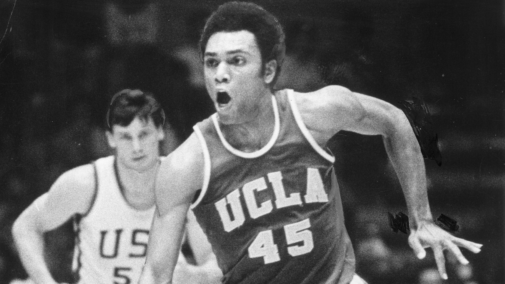SP.0722.Mccarter.Copy of 3/8/75 b&w file photo of Andre McCarter of UCLA as he makes his way down co