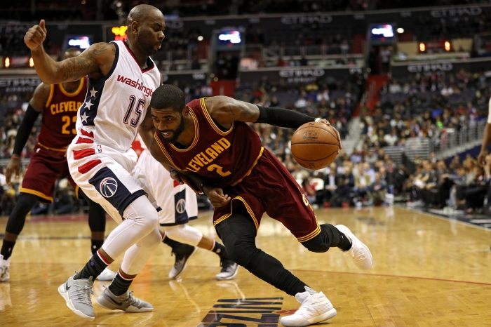 Kyrie Irving #2 of the Cleveland Cavaliers dribbles past Marcus Thornton #15 of the Washington Wizards during the first half at Verizon Center on November 11, 2016 in Washington, DC.