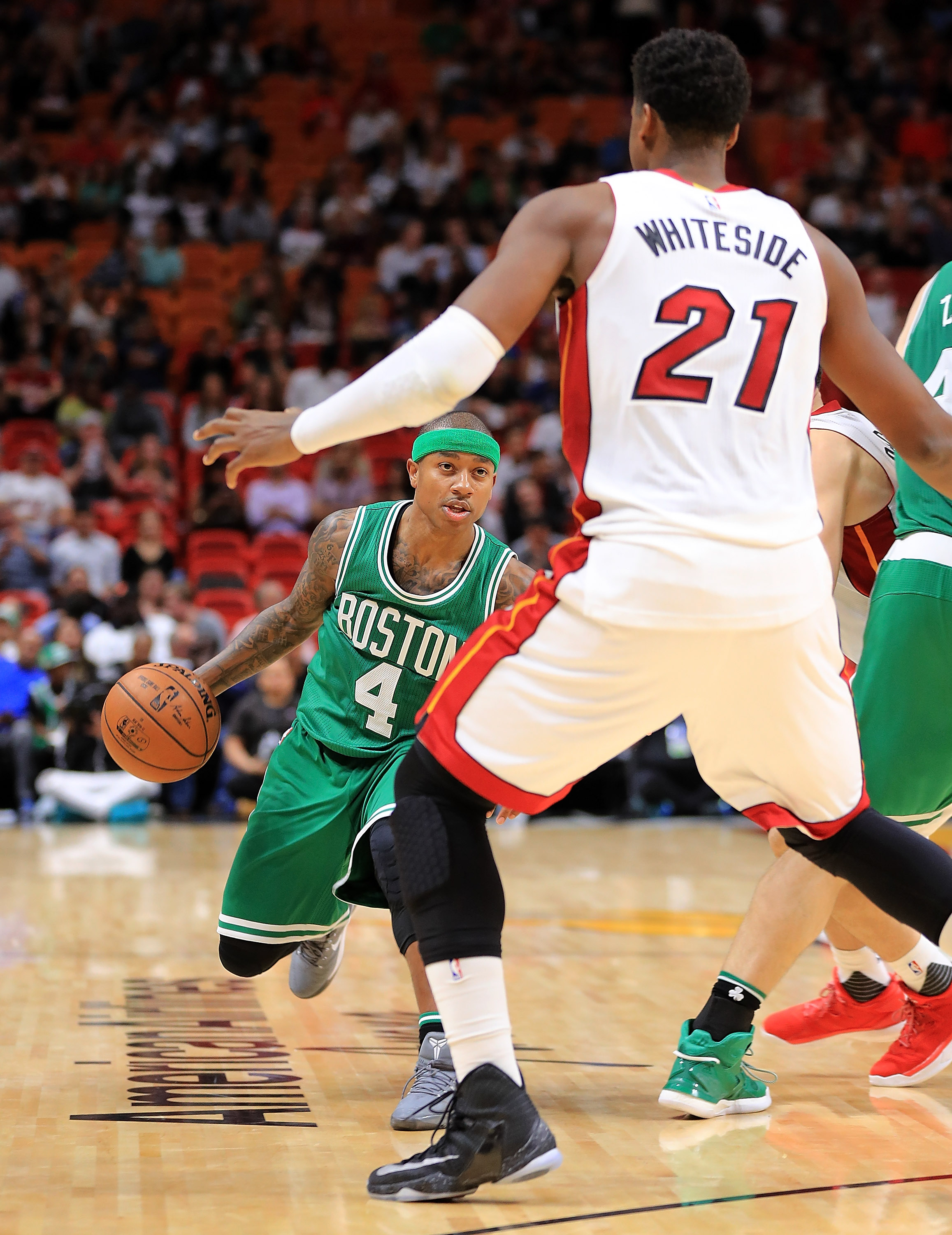 Isaiah Thomas #4 of the Boston Celtics drives on Hassan Whiteside #21 of the Miami Heat during a game at American Airlines Arena on November 28, 2016 in Miami, Florida.