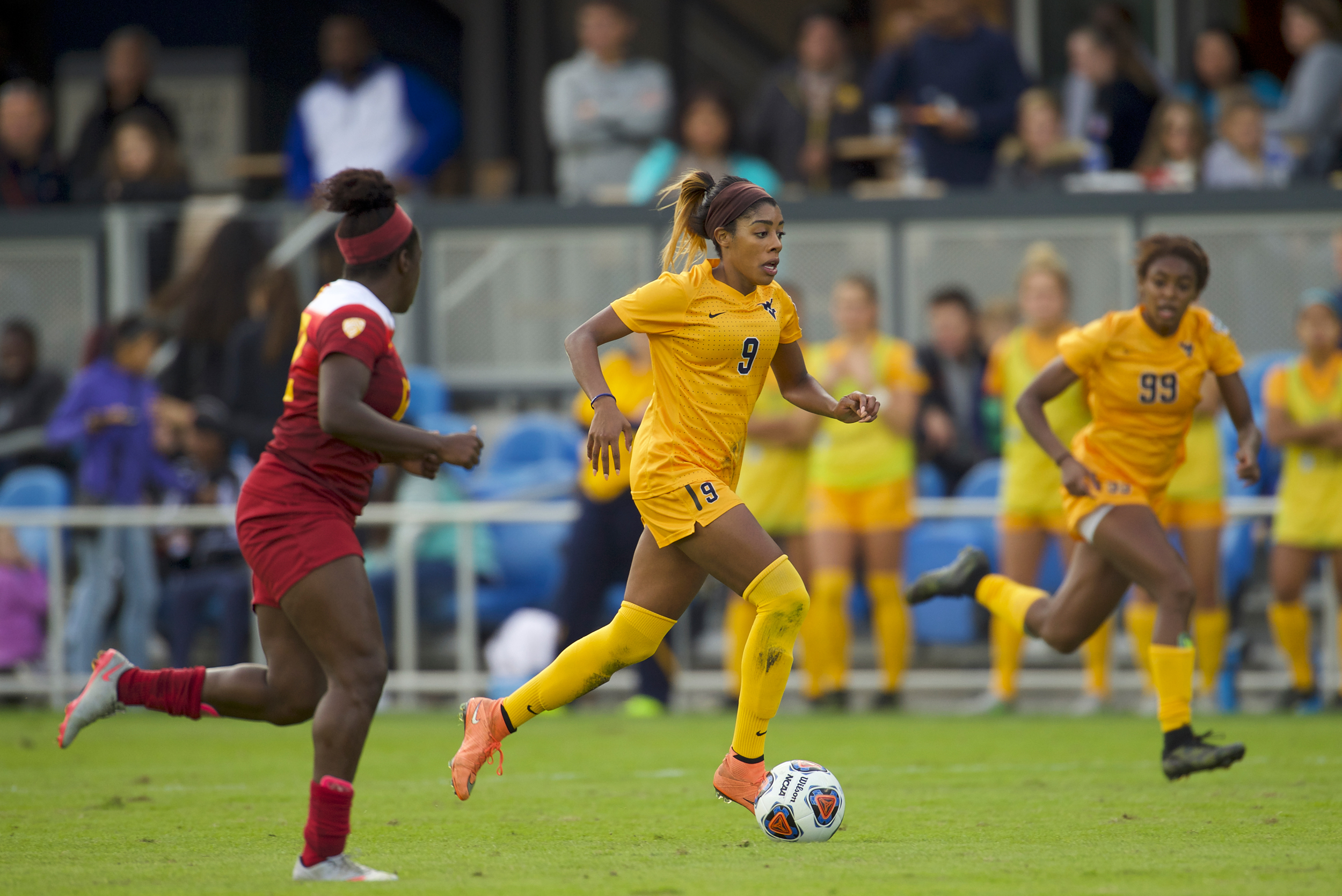 Ashley Lawrence (9) of West Virginia University pushes the ball downfield against the University of Southern California during the Division I Women's Soccer Championship held at Avaya Stadium on December 04, 2016 in San Jose, California.