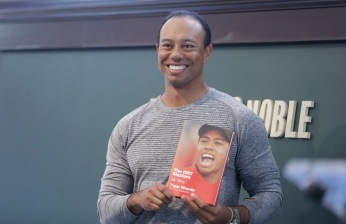 """Tiger Woods Signs Copies Of His New Book """"The 1997 Masters: My Story"""""""