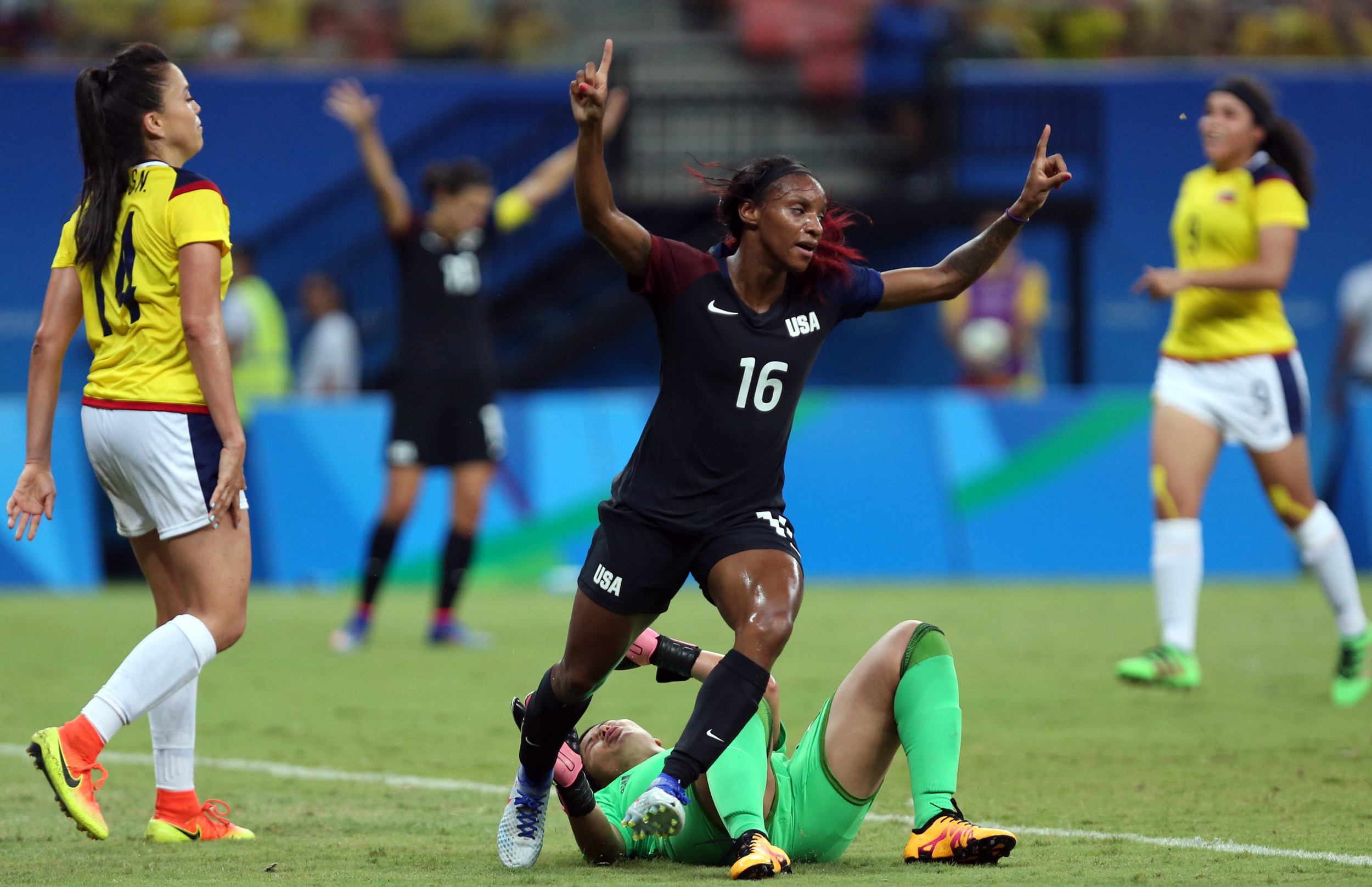 United States' Crystal Dunn, center, celebrates scoring her side's first goal during a group G match of the women's Olympic football tournament between Colombia and United States at the Arena Amazonia stadium in Manaus, Brazil, Tuesday, Aug. 9, 2016.