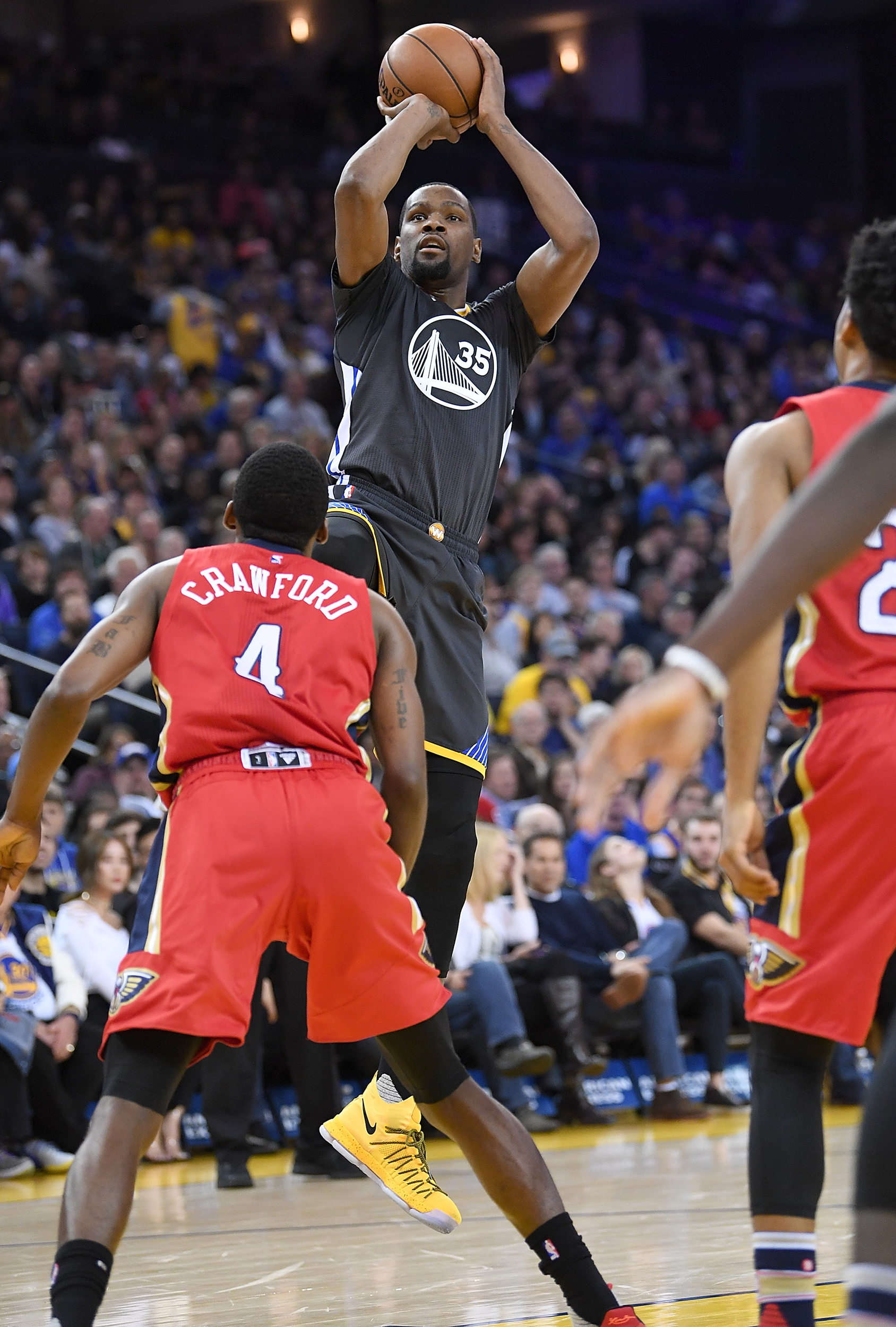 f5edfa1c4ad7 Kevin Durant (No. 35) of the Golden State Warriors goes up to shoot over  Jordan Crawford (No. 4) of the New Orleans Pelicans in the fourth quarter  of their ...