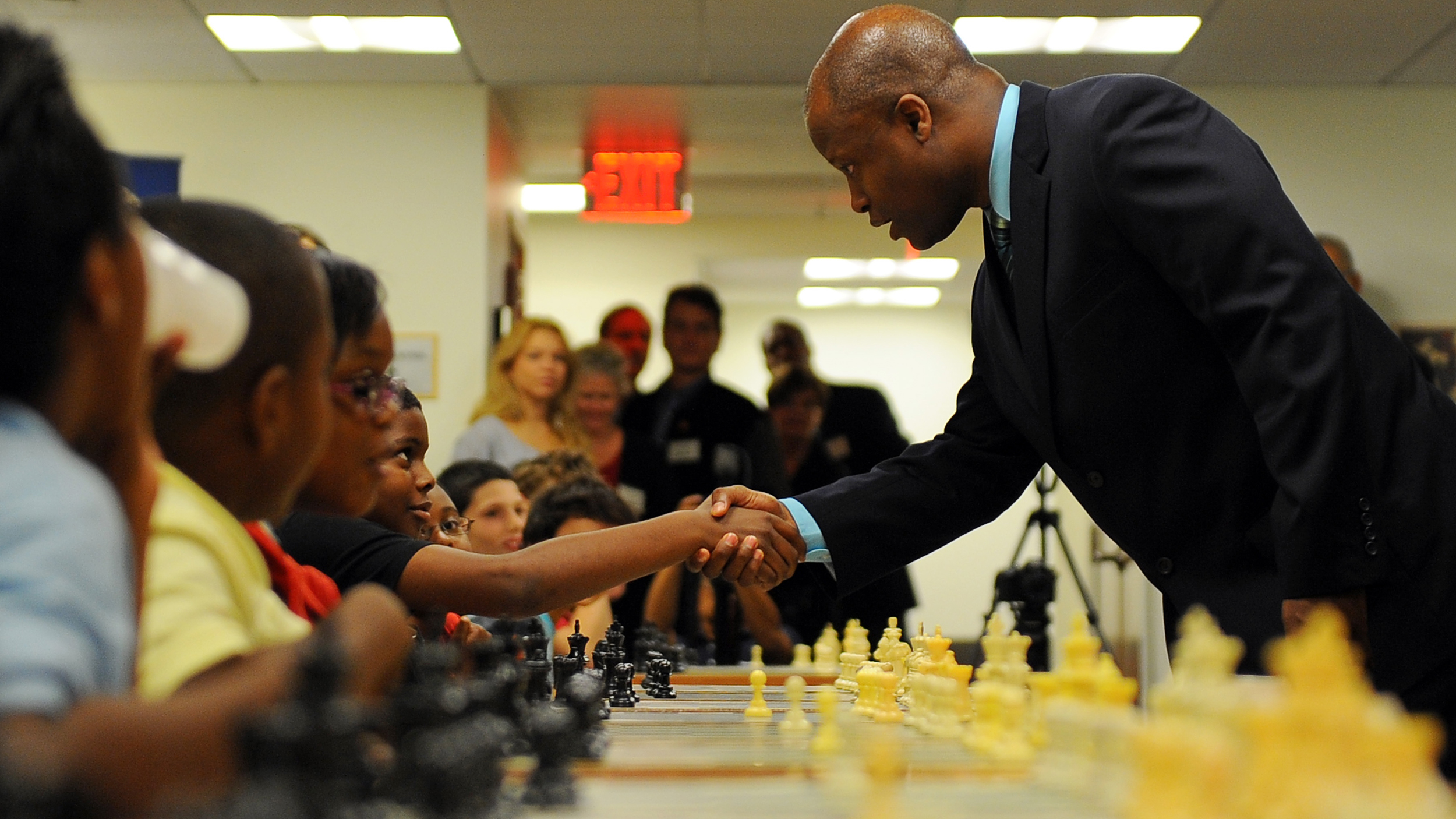 Maurice Ashley International Chess Grandmaster plays 30 school-aged children in a round of chess at the same time.