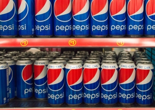 Pepsi Cola King Can on Store Shelf; Pepsi is a carbonated