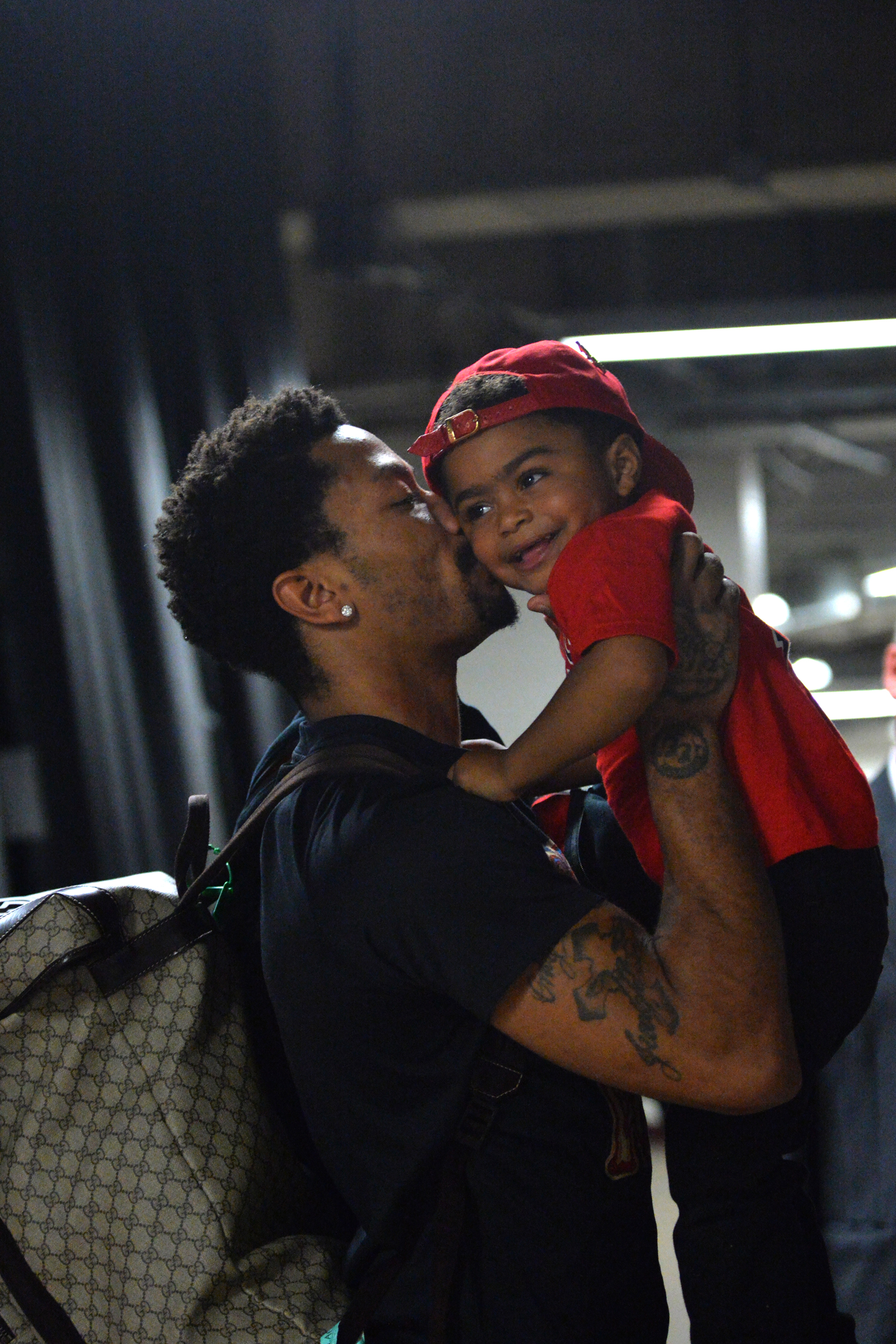 c2a94f61fc76 Derrick Rose  1 of the Chicago Bulls gives his son P.J. a kiss after  hitting the game winning shot against the Cleveland Cavaliers at the United  Center ...