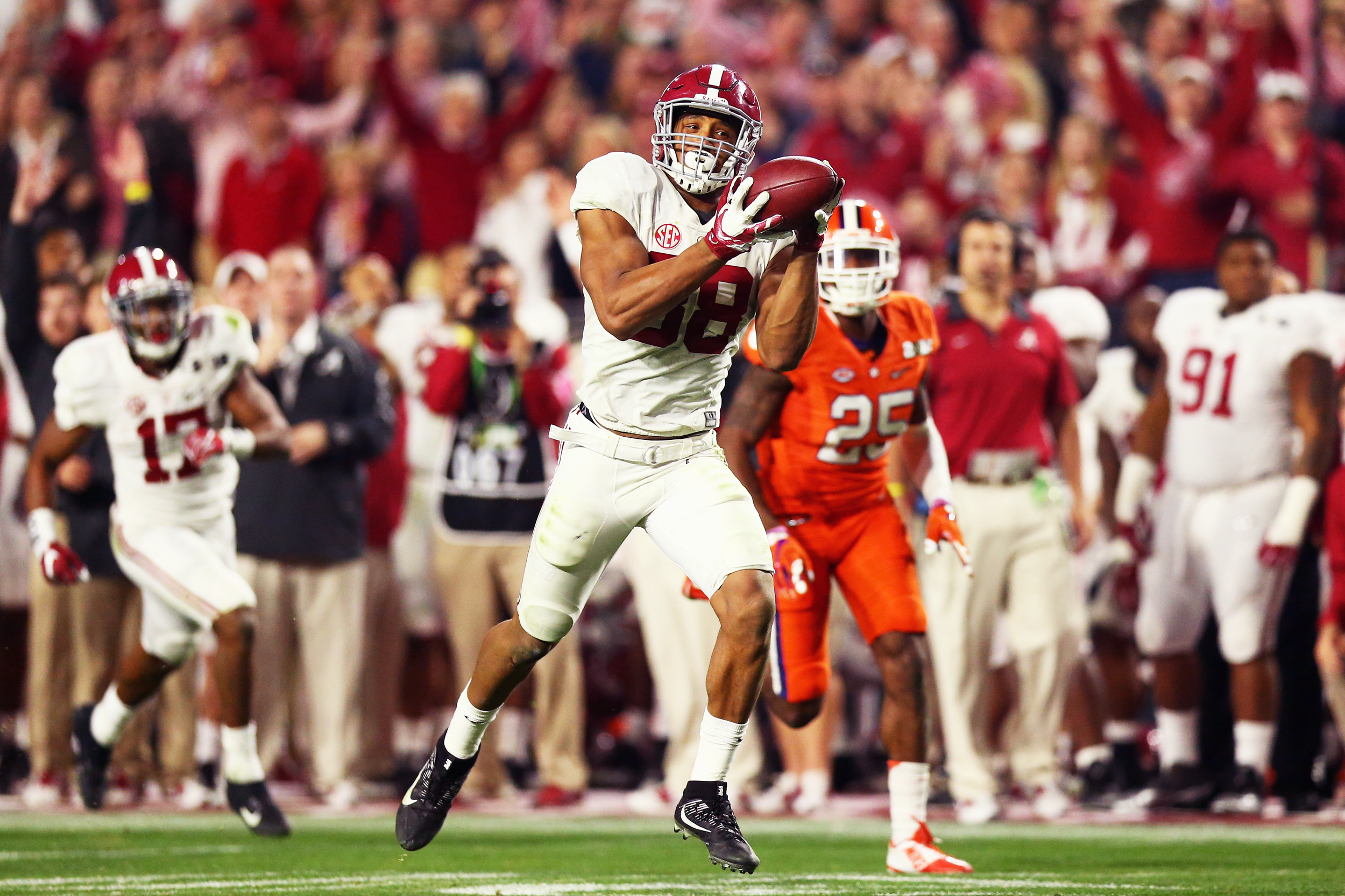 ad26d7c5a09 O.J. Howard #88 of the Alabama Crimson Tide scores a 51-yard touchdown in  the fourth quarter against the Clemson Tigers during the 2016 College  Football ...