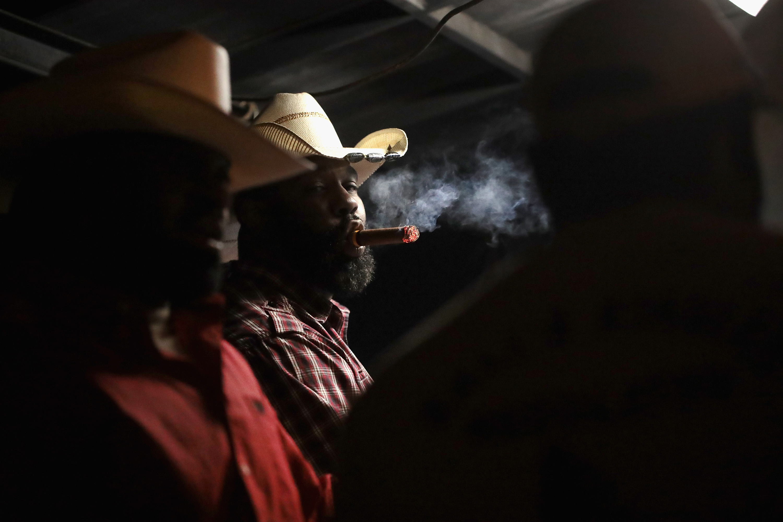a93513f0cfc Cowboys relax at a late-night barbecue following a day of competition at  the Bill Pickett Invitational Rodeo on April 1 in Memphis