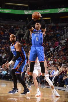 e62c2116255 Russell Westbrook  0 of the Oklahoma City Thunder shoots the ball against  the Phoenix Suns on April 7