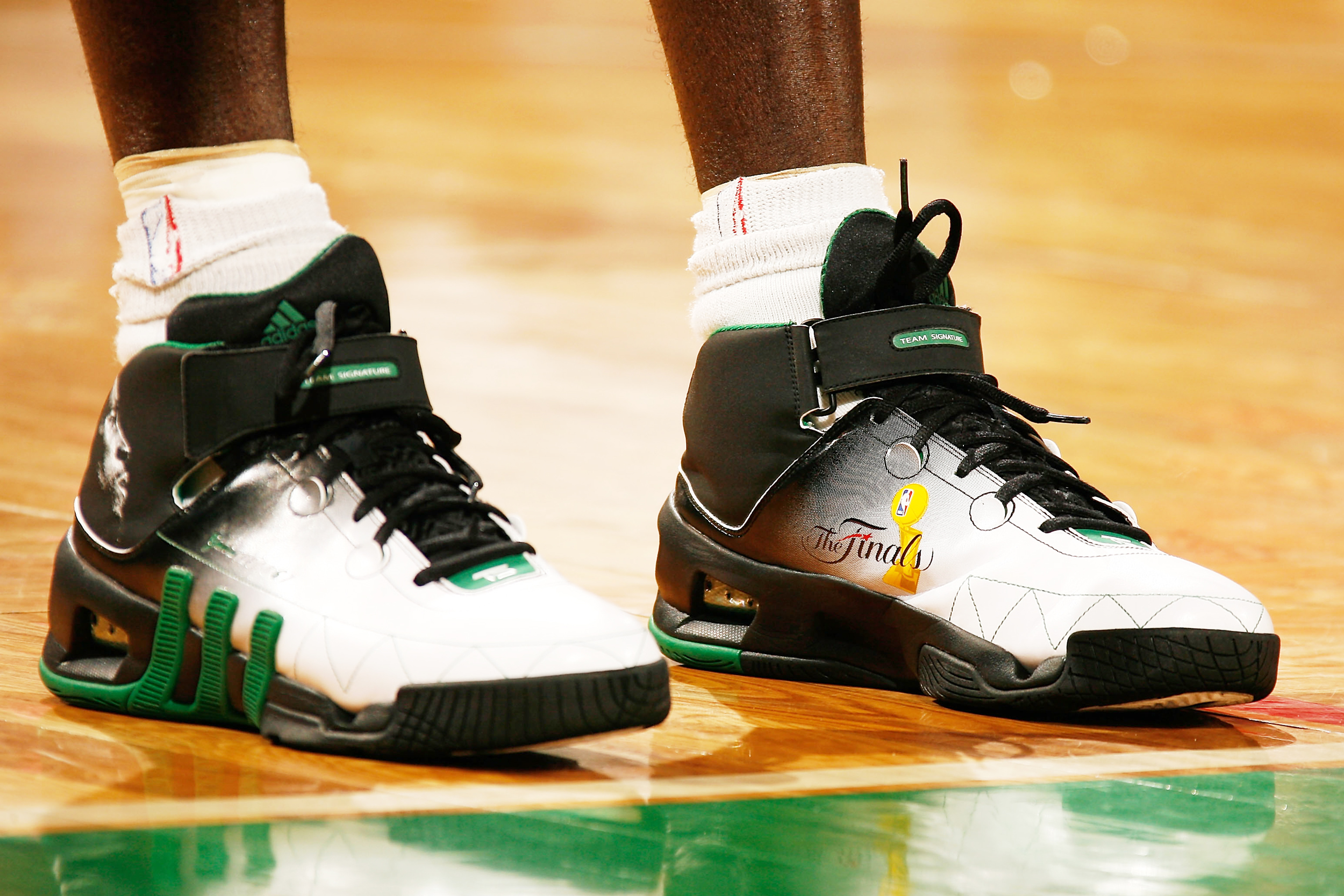 eaa95dbc943 Kevin Garnett of the Boston Celtics wears a pair of unique Adidas sneakers  in honor of the 2008 NBA Finals against the Los Angeles Lakers on June 17