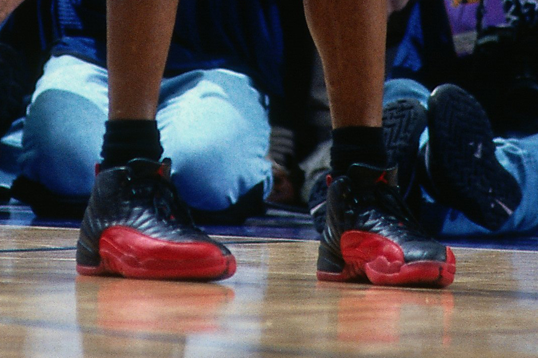 73a0e3beb8b Michael Jordan (No. 23) of the Chicago Bulls rests during Game 5 of the  1997 NBA Finals played against the Utah Jazz on June 11
