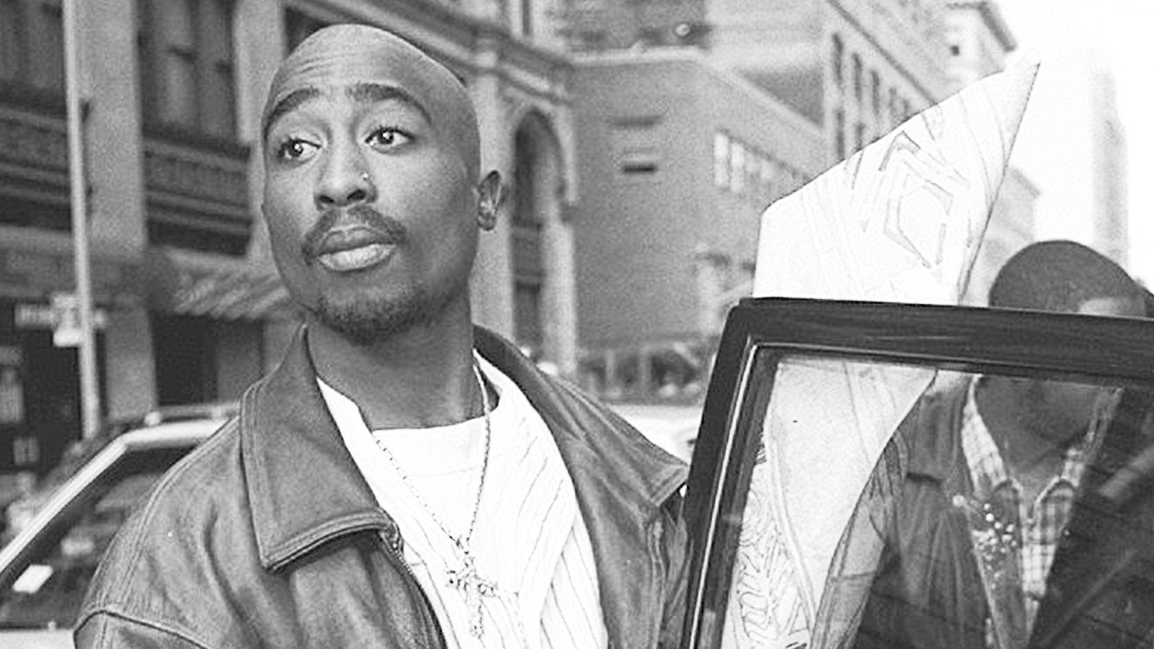 Tupac Shakur outside criminal court.