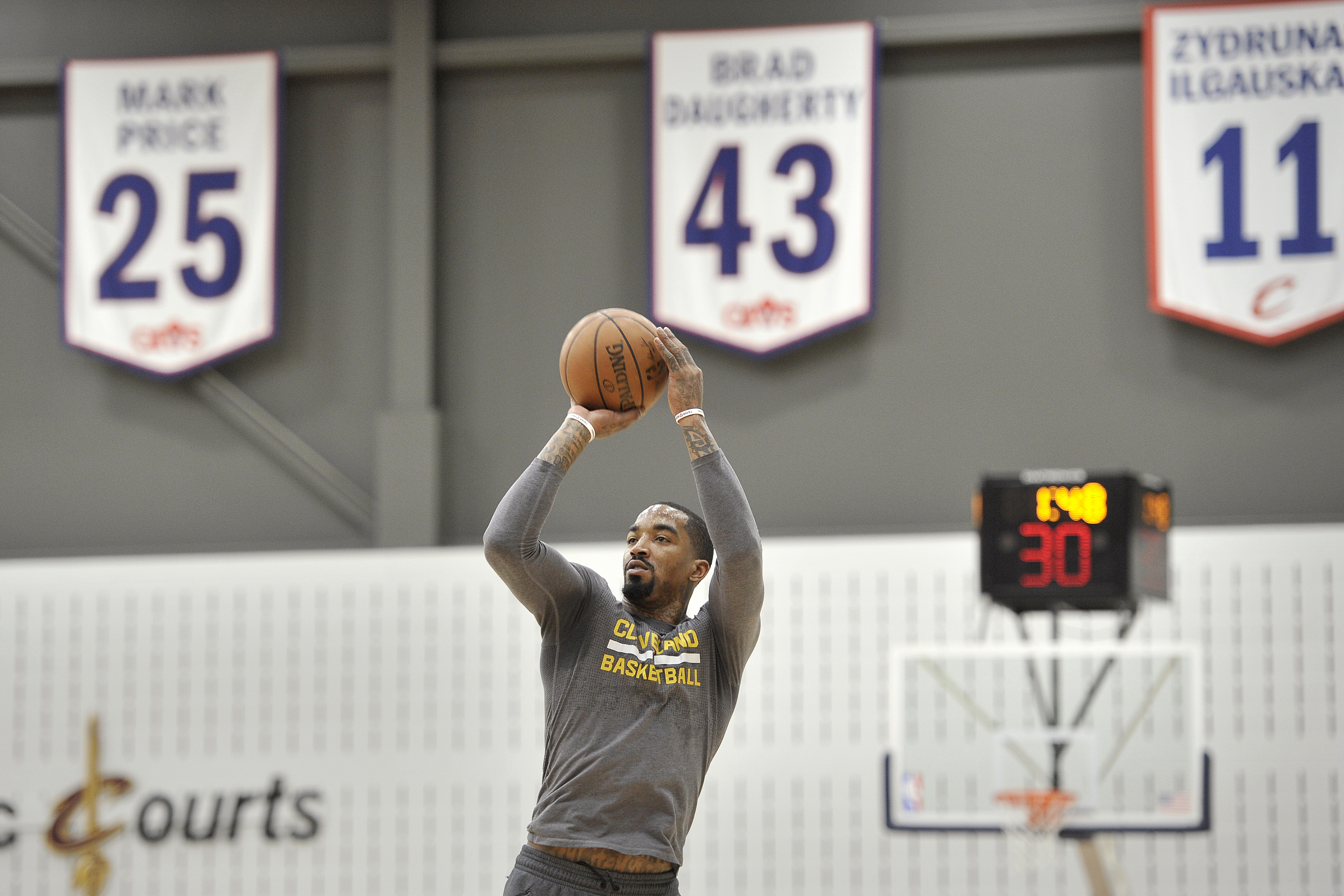 4f0c1559b92806 J.R. Smith #5 of the Cleveland Cavaliers shoots the ball during an  all-access practice at The Cleveland Clinic Courts on April 28, 2016 in  Independence, ...