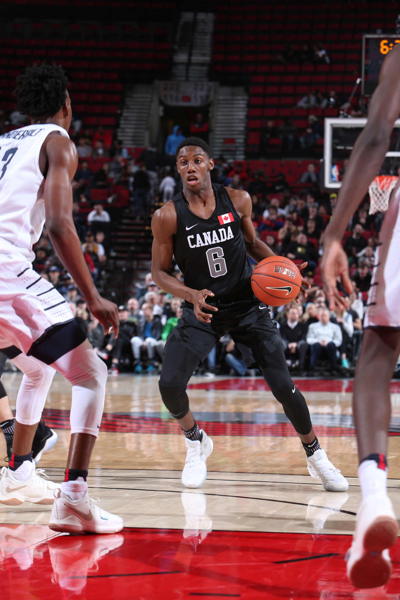 promo code 19d4c cf4af R.J. Barrett  6 of the World Select Team drives against the USA Junior  Select Team during the game on April 7, 2017 at the MODA Center Arena in  Portland, ...