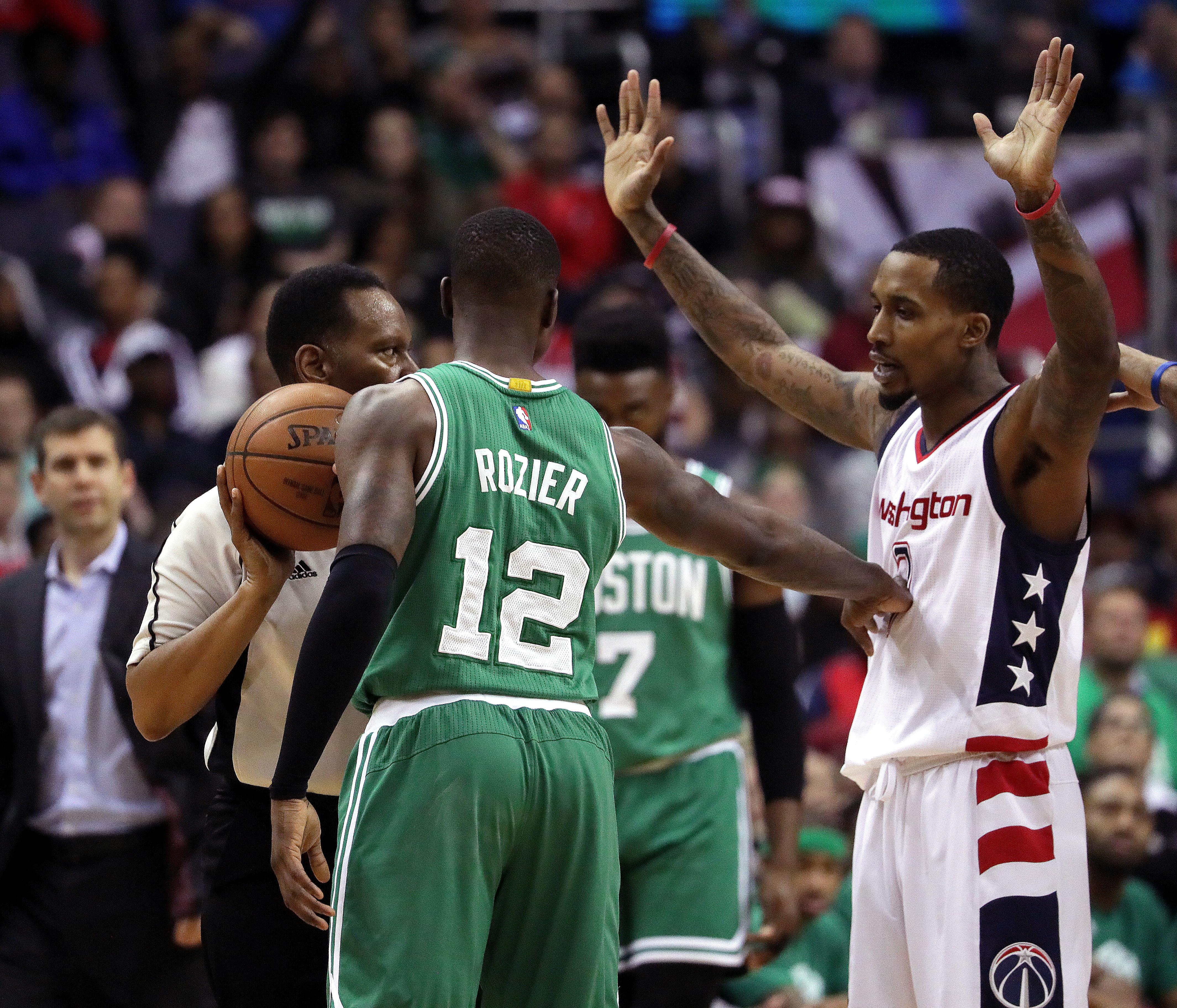 Boston Celtics guard Terry Rozier (12) and Washington Wizards guard Brandon  Jennings (7) get into a shoving match during the fourth quarter. 0e64836e5
