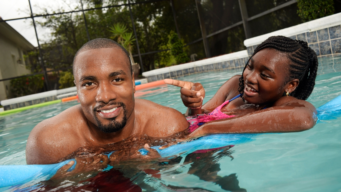 Serge Ibaka and his daughter in a pool