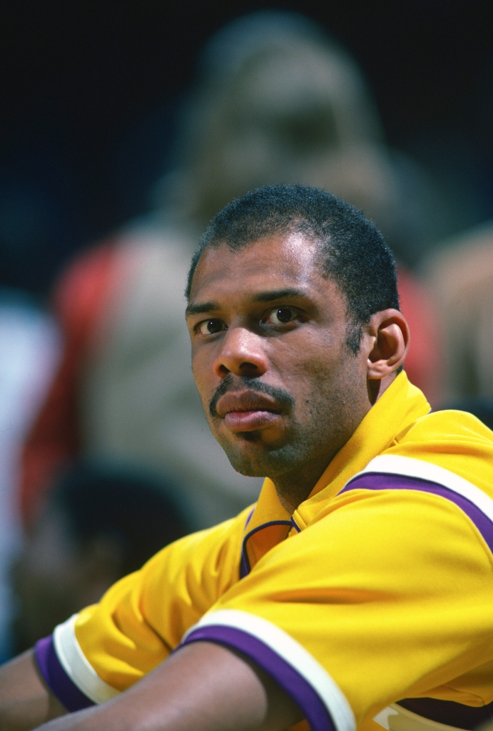 Kareem Abdul-Jabbar  33 of the Los Angeles Lakers looks on from the bench  against the Boston Celtics during an NBA basketball game circa 1984 at The  Forum ... 6e87e597d