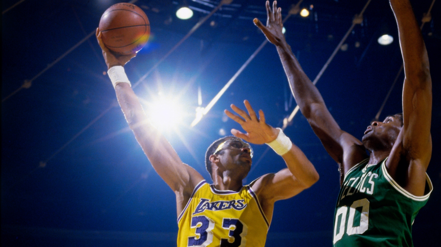 Kareem Abdul-Jabbar  33 of the Los Angeles Lakers shoots the ball against  Robert Parish  00 of the Boston Celtics during a game in 1984 at the Great  Western ... b5a6c6f9c8