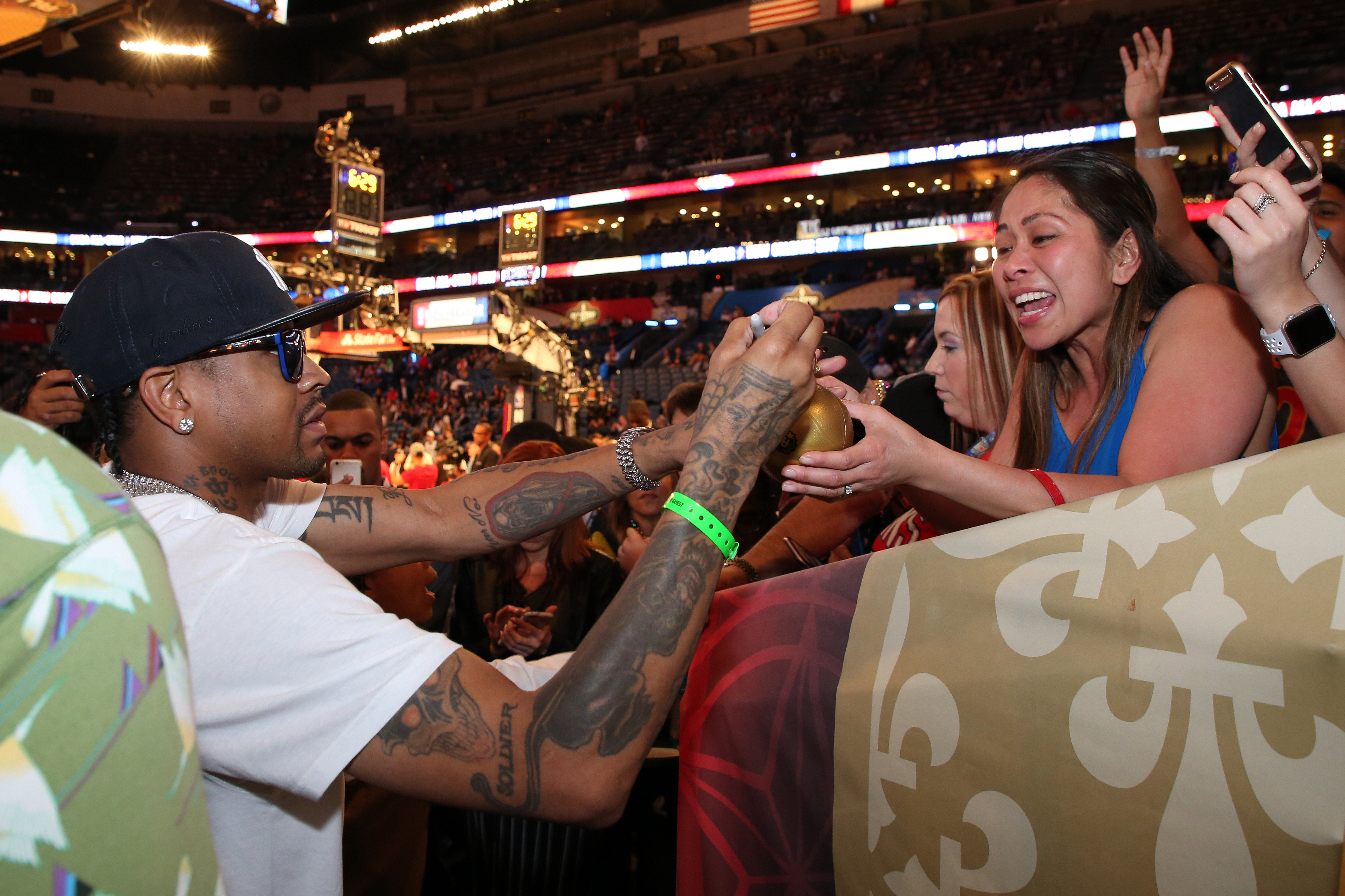 127c3bd602c54 NBA legend Allen Iverson signs autographs before the NBA All-Star Game as  part of the 2017 NBA All-Star Weekend on Feb. 19 at the Smoothie King  Center in ...