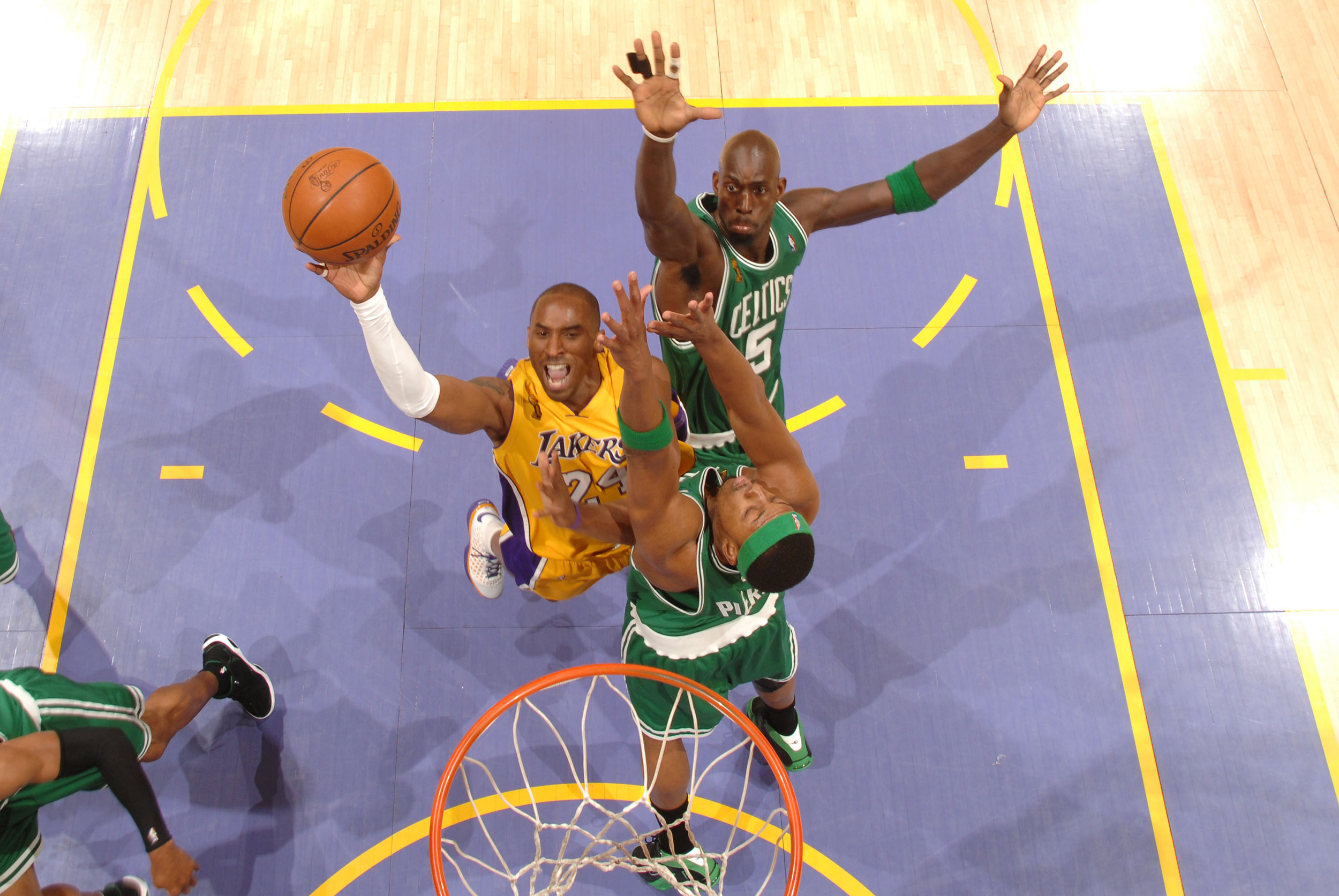 3204d76f53b Kobe Bryant (No. 24) of the Los Angeles Lakers attempts a shot against the  defense of Kevin Garnett (No. 5) of the Boston Celtics in Game 4 of the 2008  NBA ...