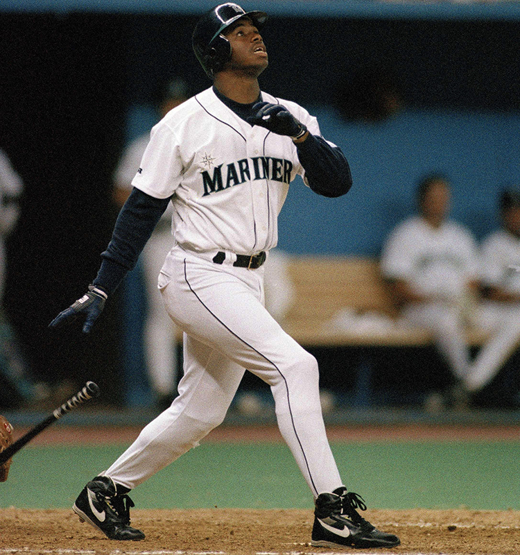 91b7331732 Ken Griffey Jr. of the Seattle Mariners drops his bat after belting a  seventh-inning homer in Seattle during a game against the Minnesota Twins on  July 28, ...