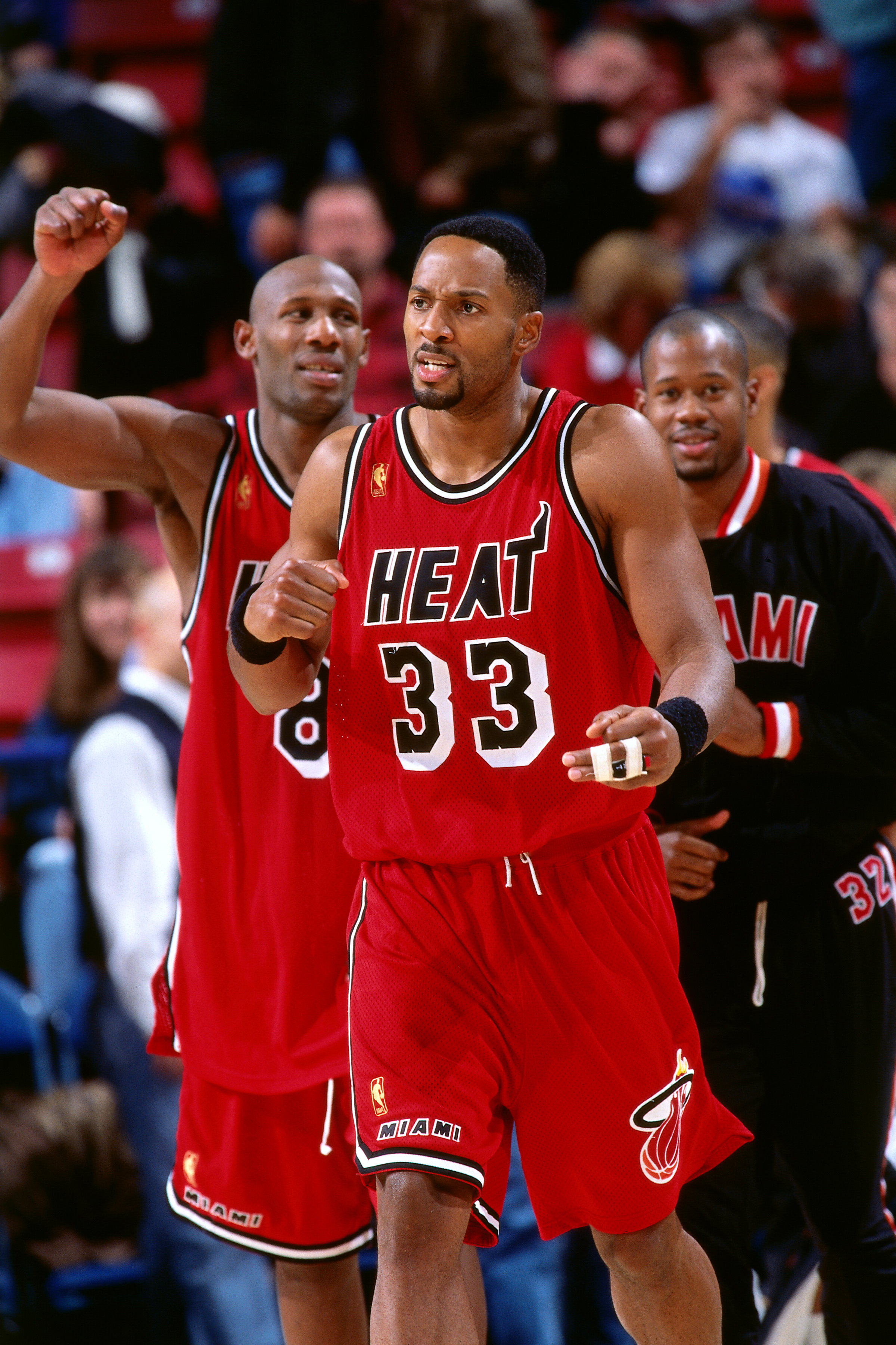 851ebbda0c7 Alonzo Mourning (No. 33) of the Miami Heat celebrates against the  Sacramento Kings on Nov. 22