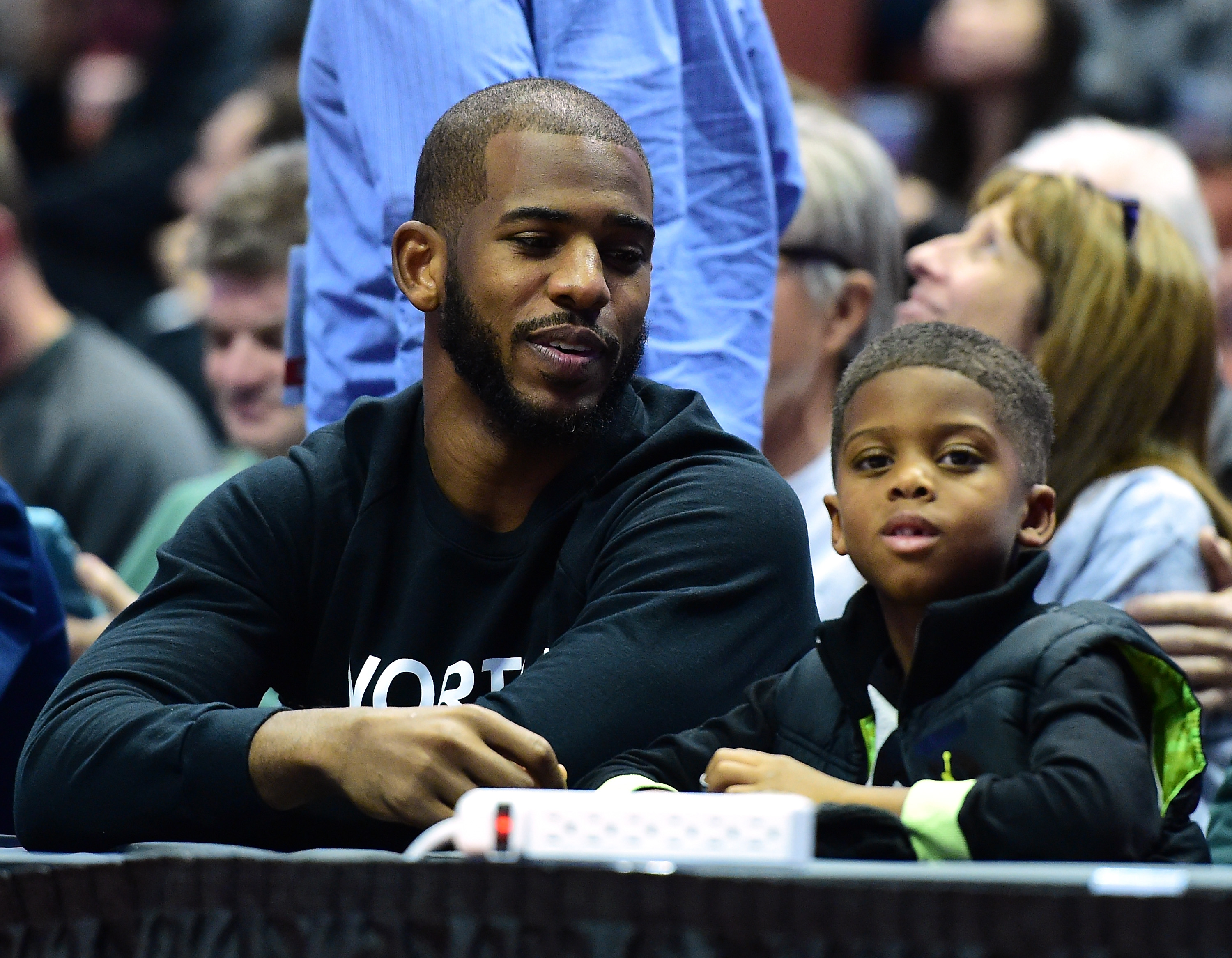 dd466f48f161cf Chris Paul of the Los Angeles Clippers and his son Chris watch the game  between the Michigan State Spartans and the Providence Friars during the ...